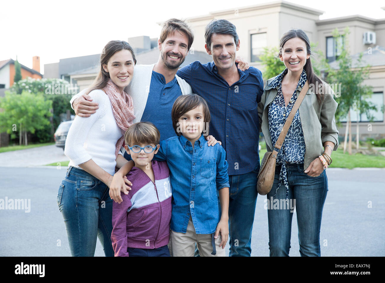 Family posing together on suburban street, portrait Stock Photo
