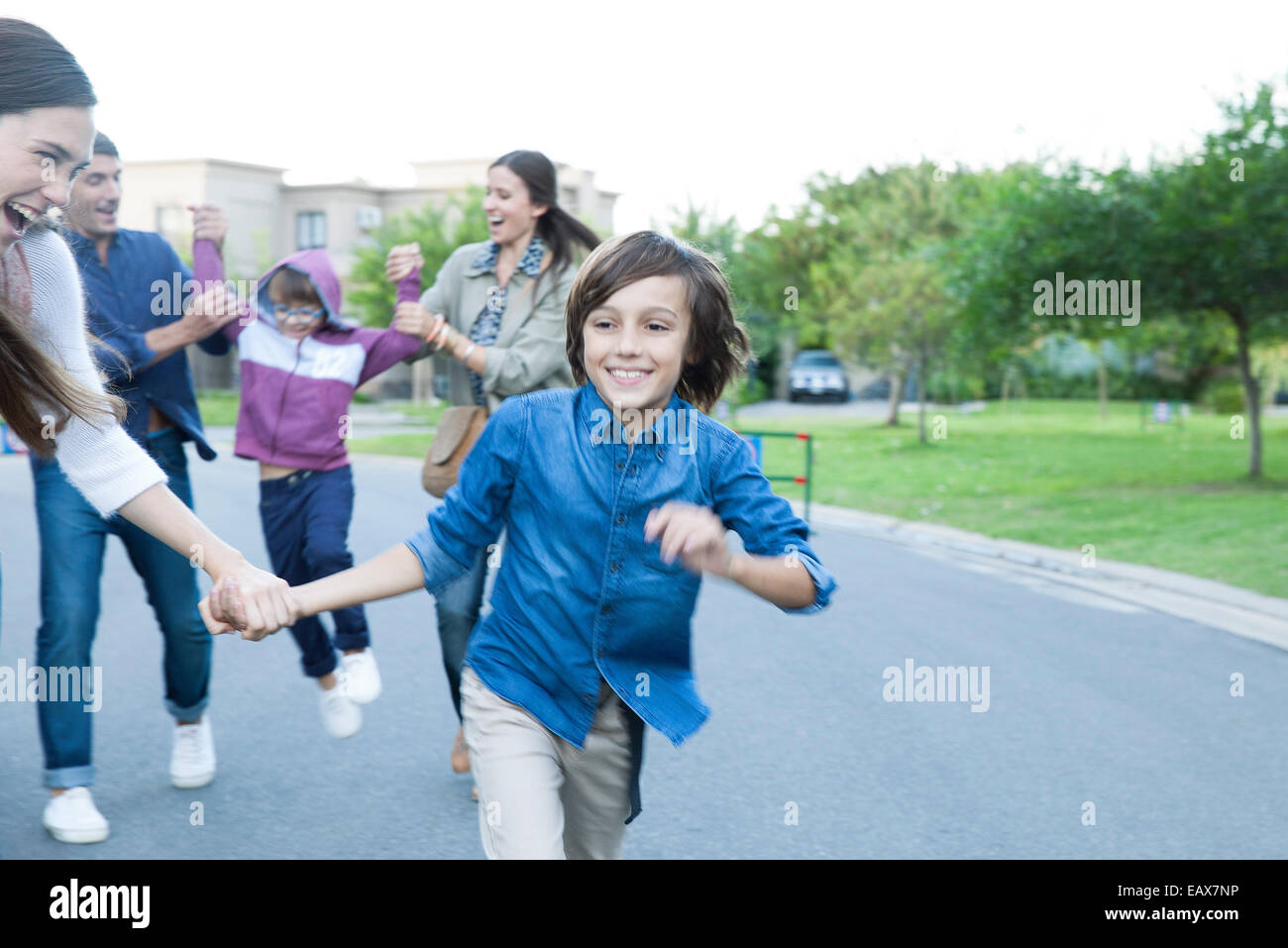 Family playing together outdoors Stock Photo