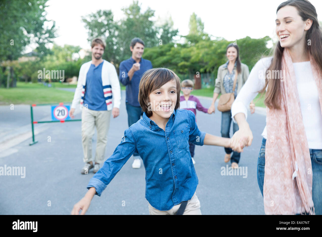 Family walking together outdoors - Stock Image