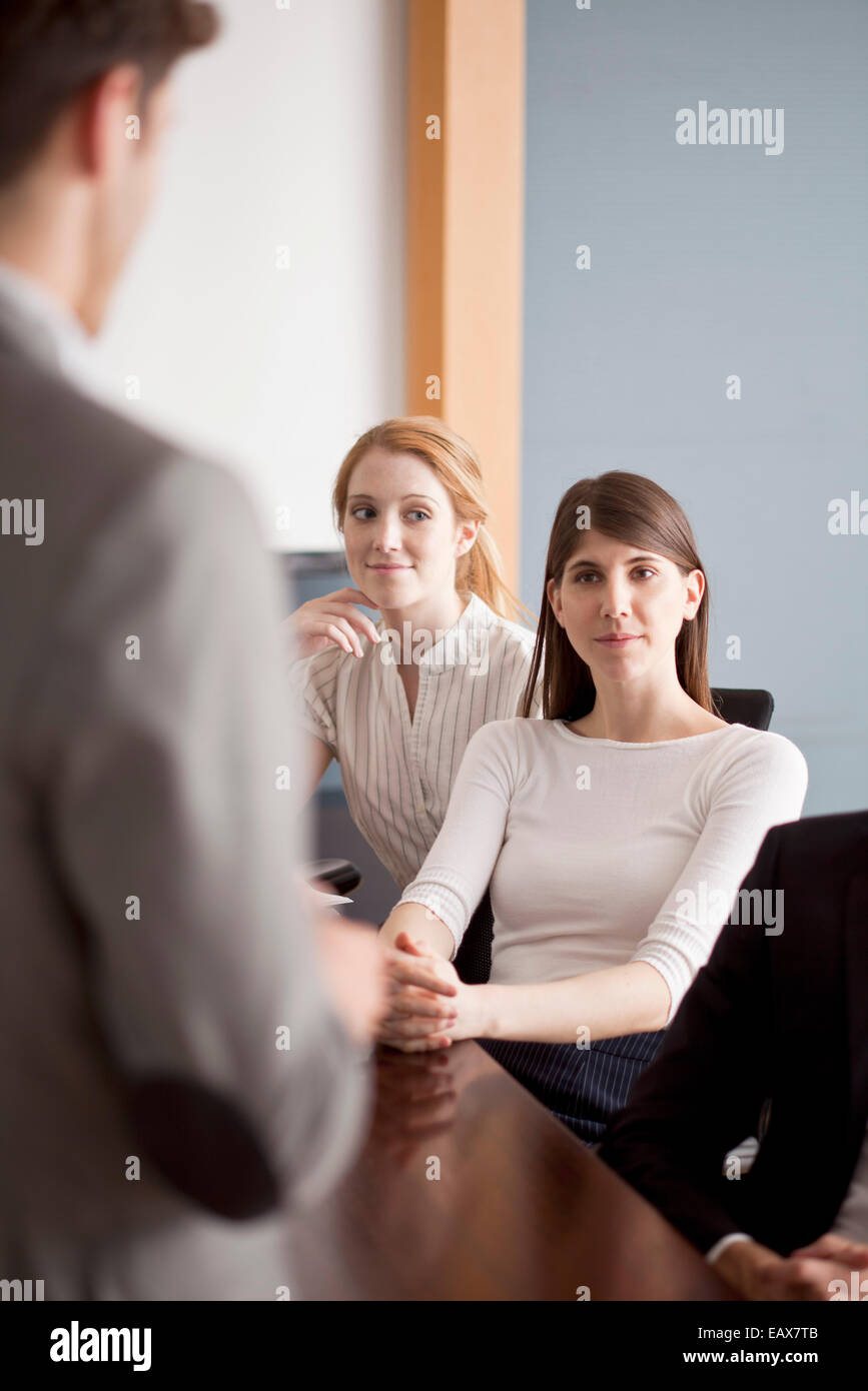 Business professionals attending presentation - Stock Image