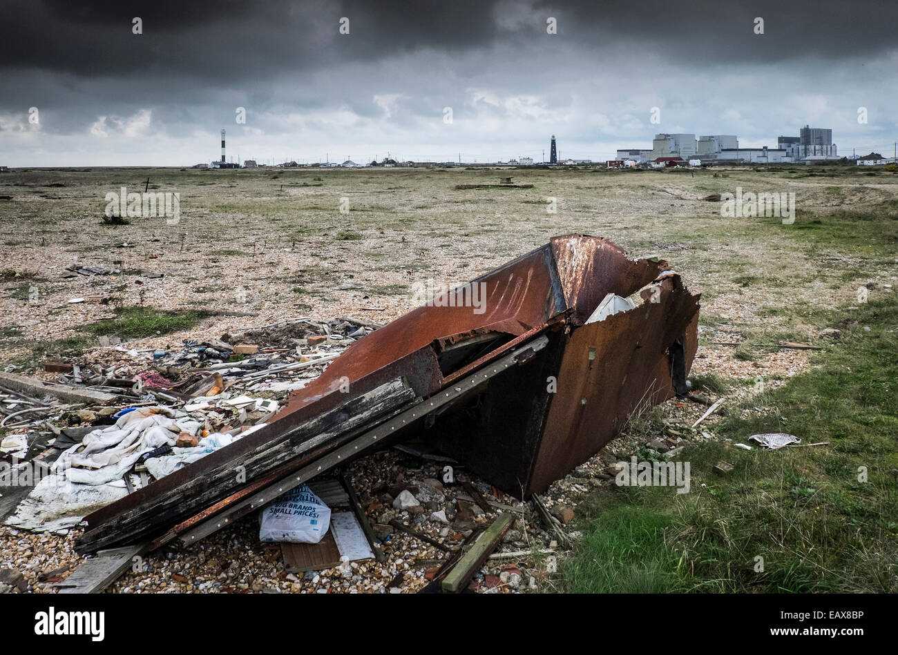 Various items of rubbish left on the foreland at Dungeness in Kent.  A site of special scientific significance. - Stock Image
