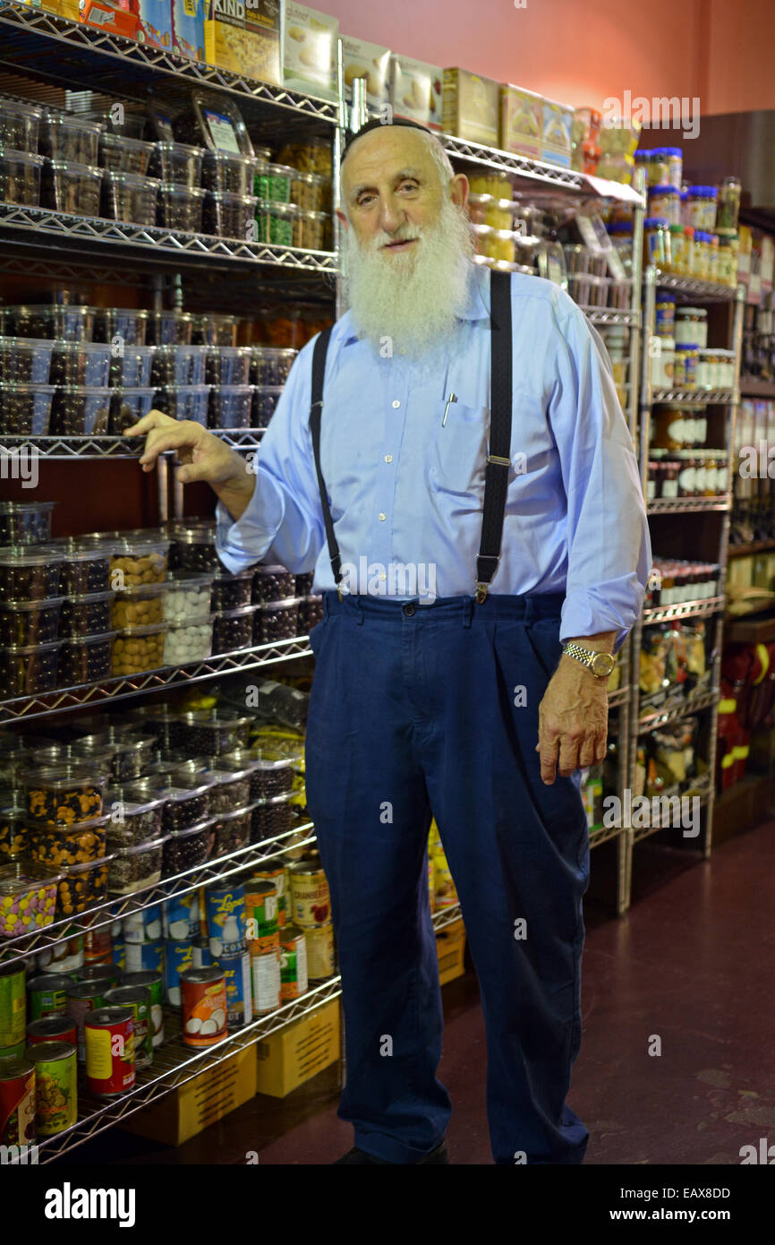Religious Jewish owner of a small Kosher supermarket in the Crown Heights, Brooklyn, New York Stock Photo