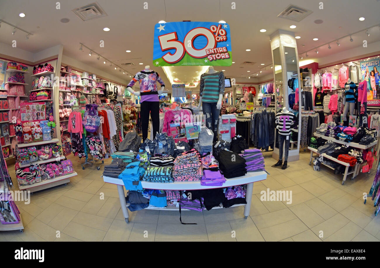 ebca4c404 Fisheye lens view of a girl's clothing store called Justice at Roosevelt  Field mall with a 50% off sale. In Garden City LI, NY.