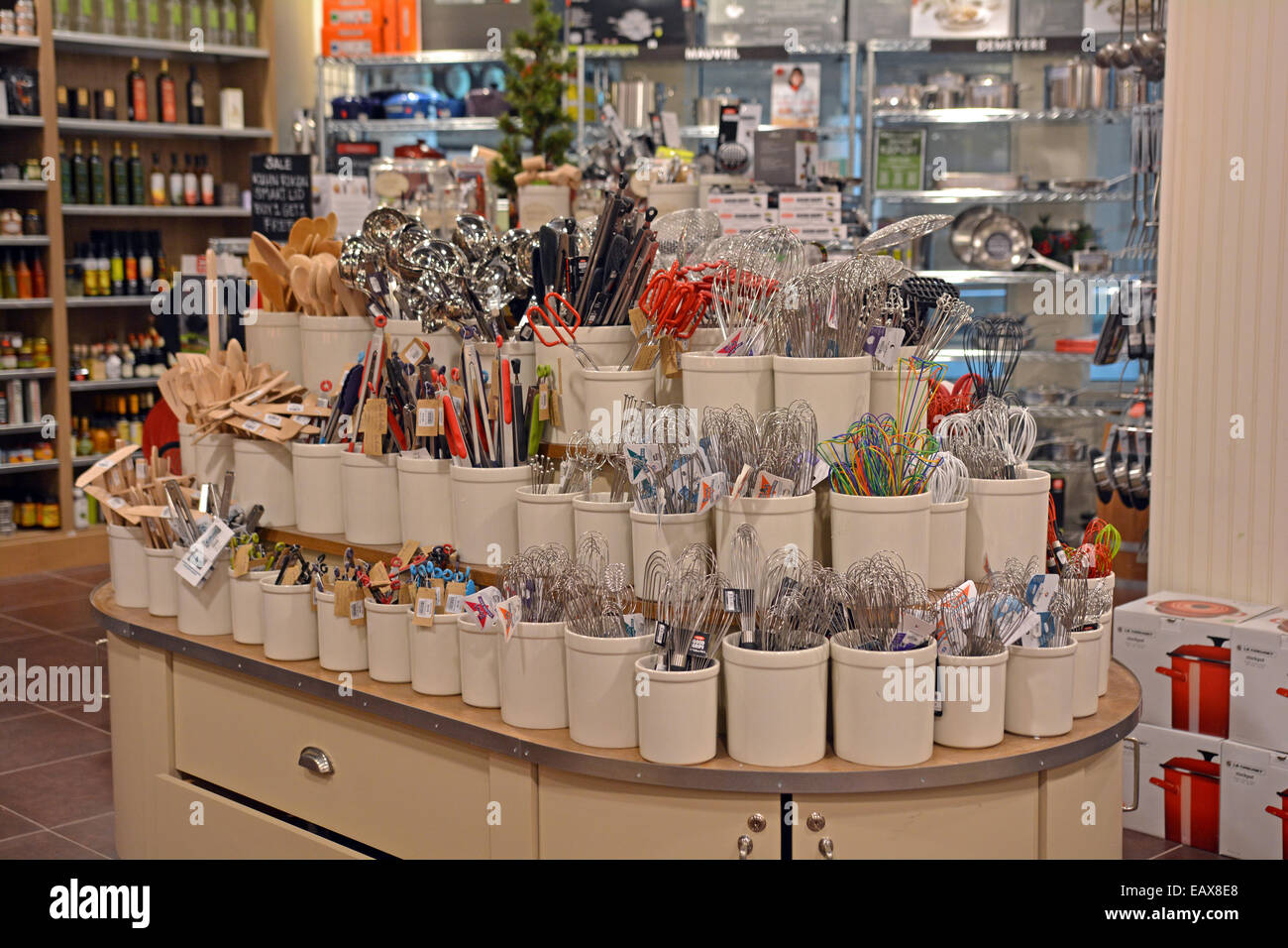 A view of cooking utensils for sale at the SUR LA TABLE store in Roosevelt Field Mall in Garden City, Long Island, - Stock Image