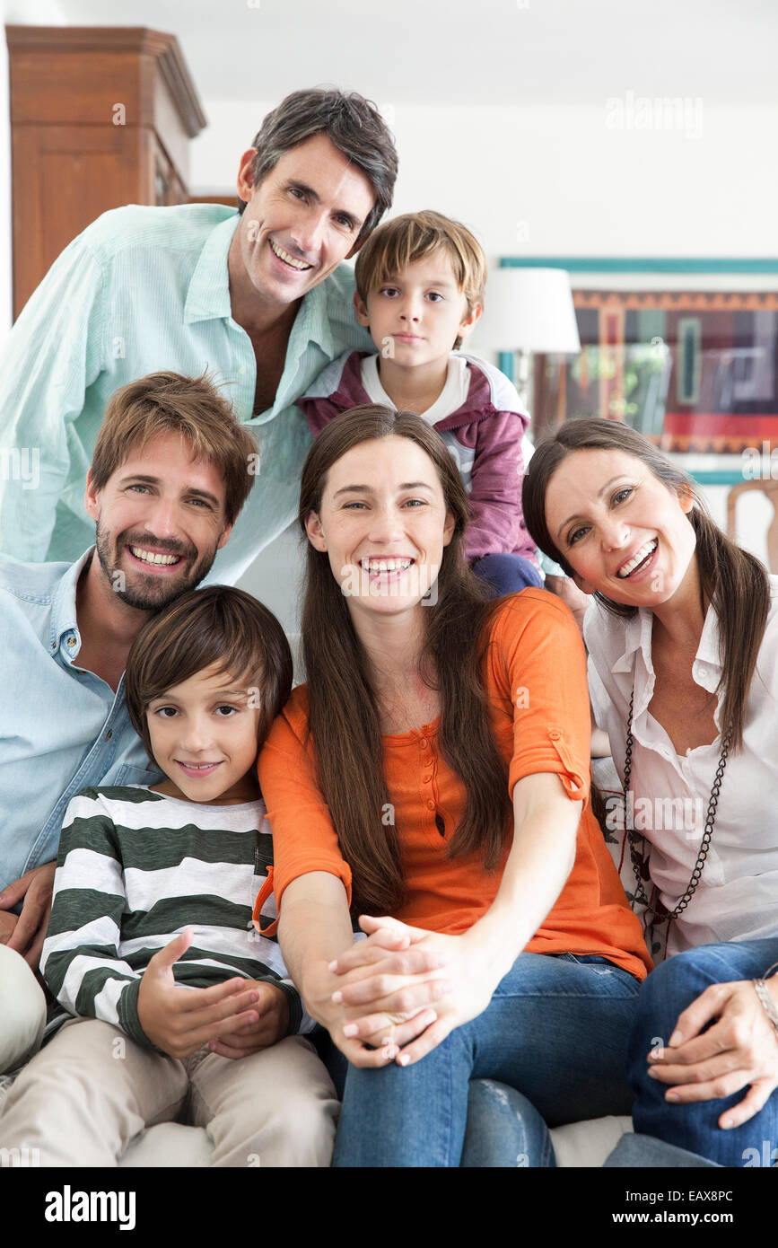 Family together in living room, portrait Stock Photo