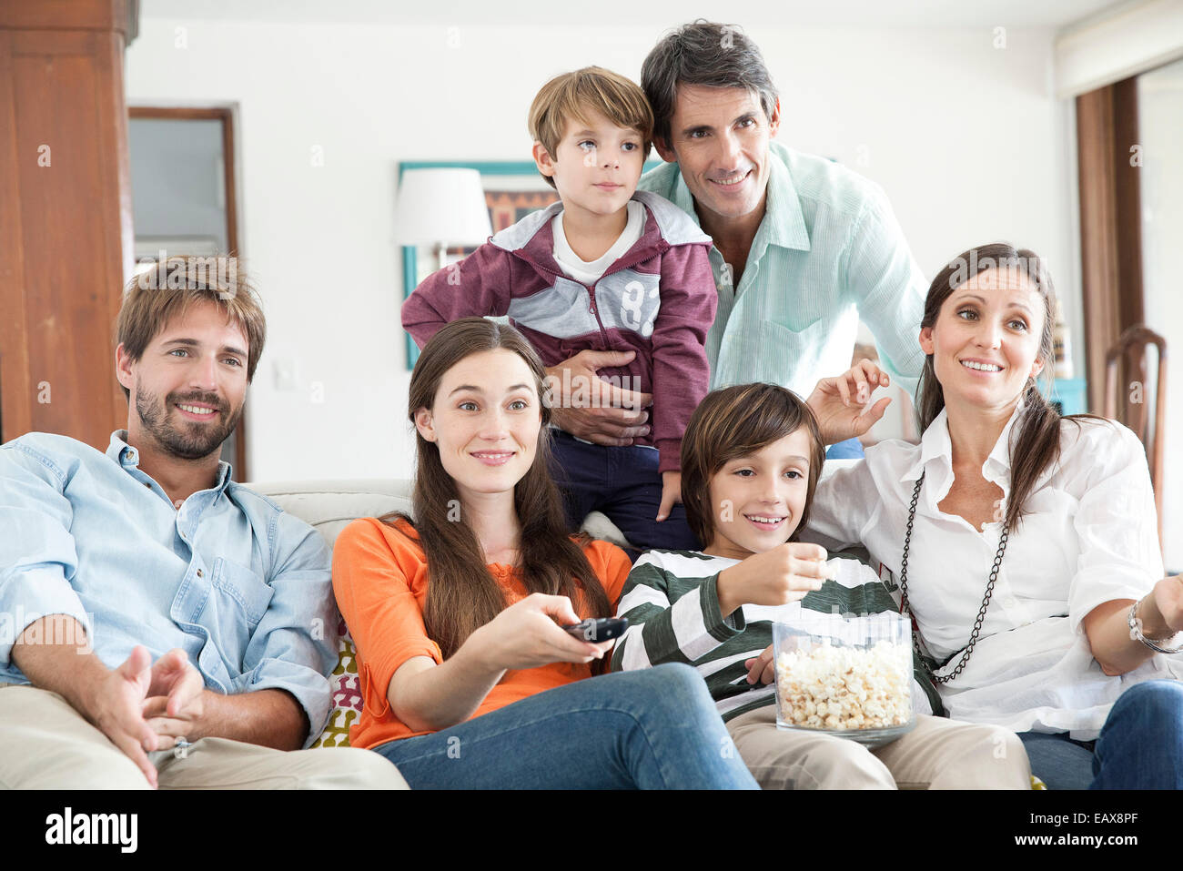 Family watching TV together - Stock Image