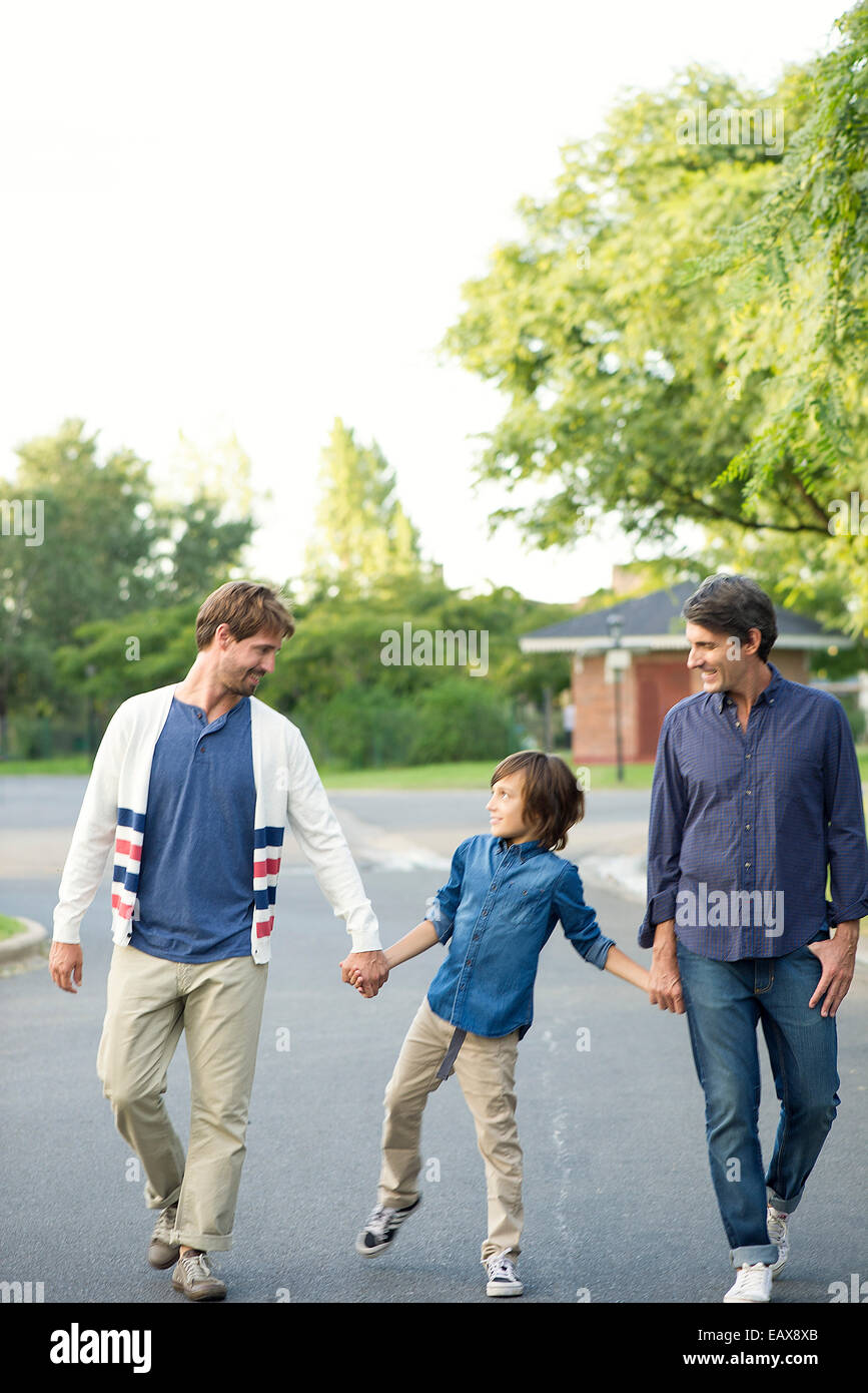 Boy walking with his fathers outdoors - Stock Image