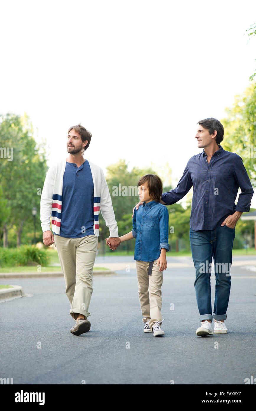 Fathers and son walking together outdoors - Stock Image