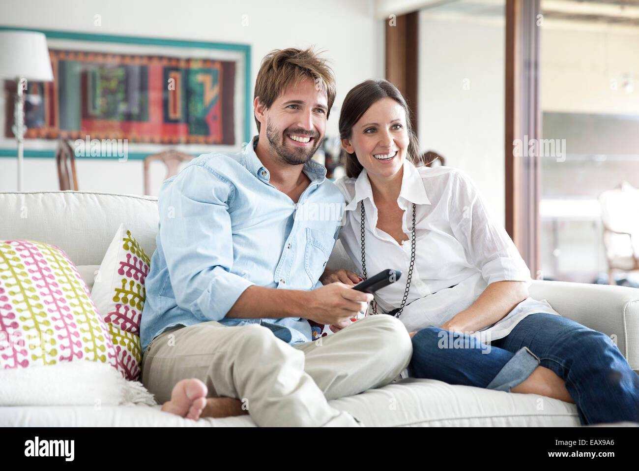 Couple watching TV together - Stock Image