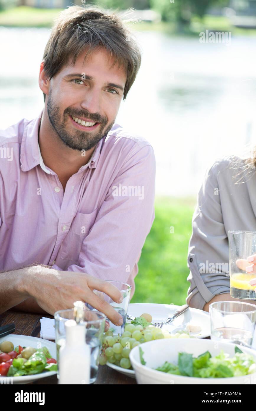 Man relaxing at picnic - Stock Image