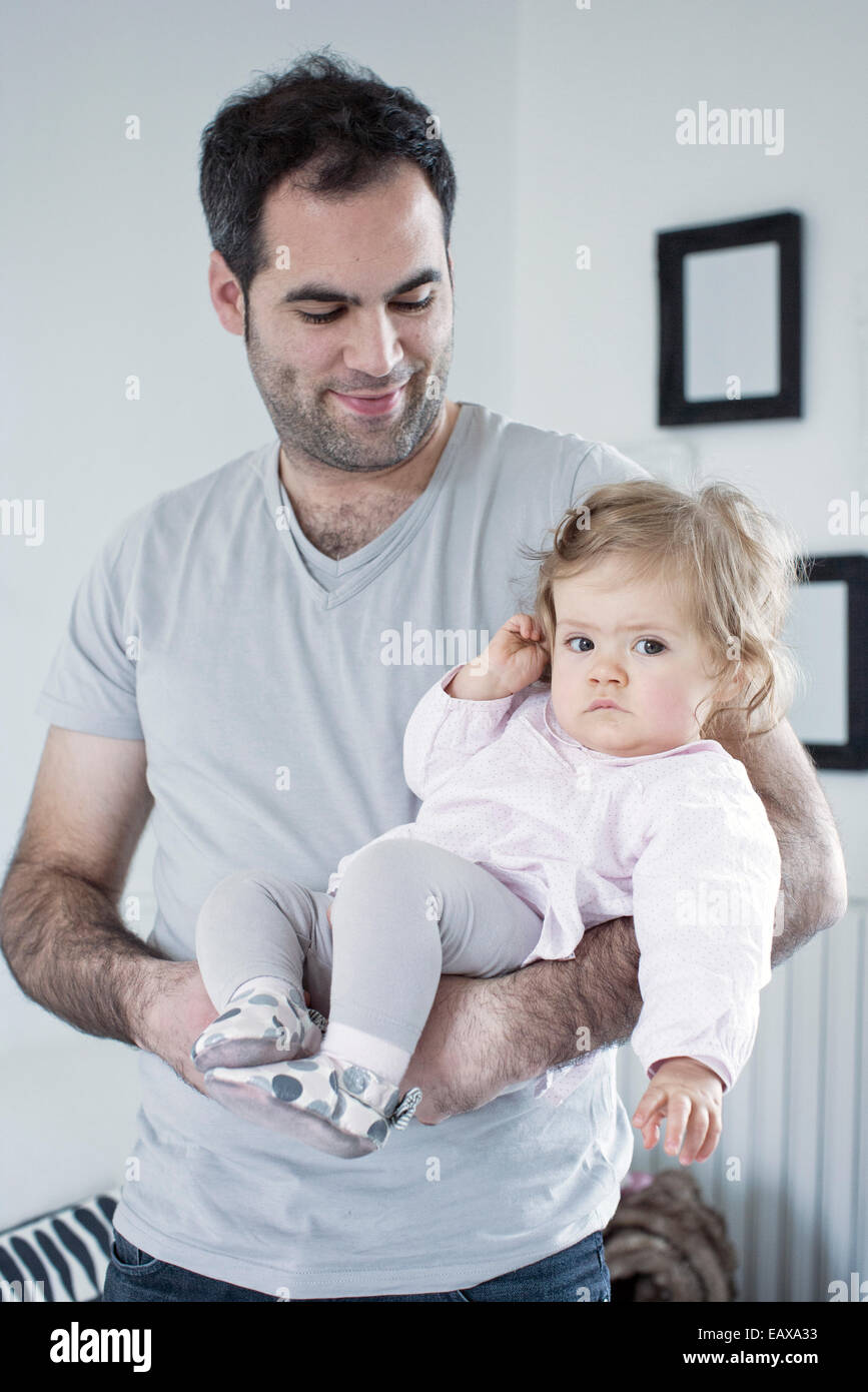 Father holding baby girl - Stock Image