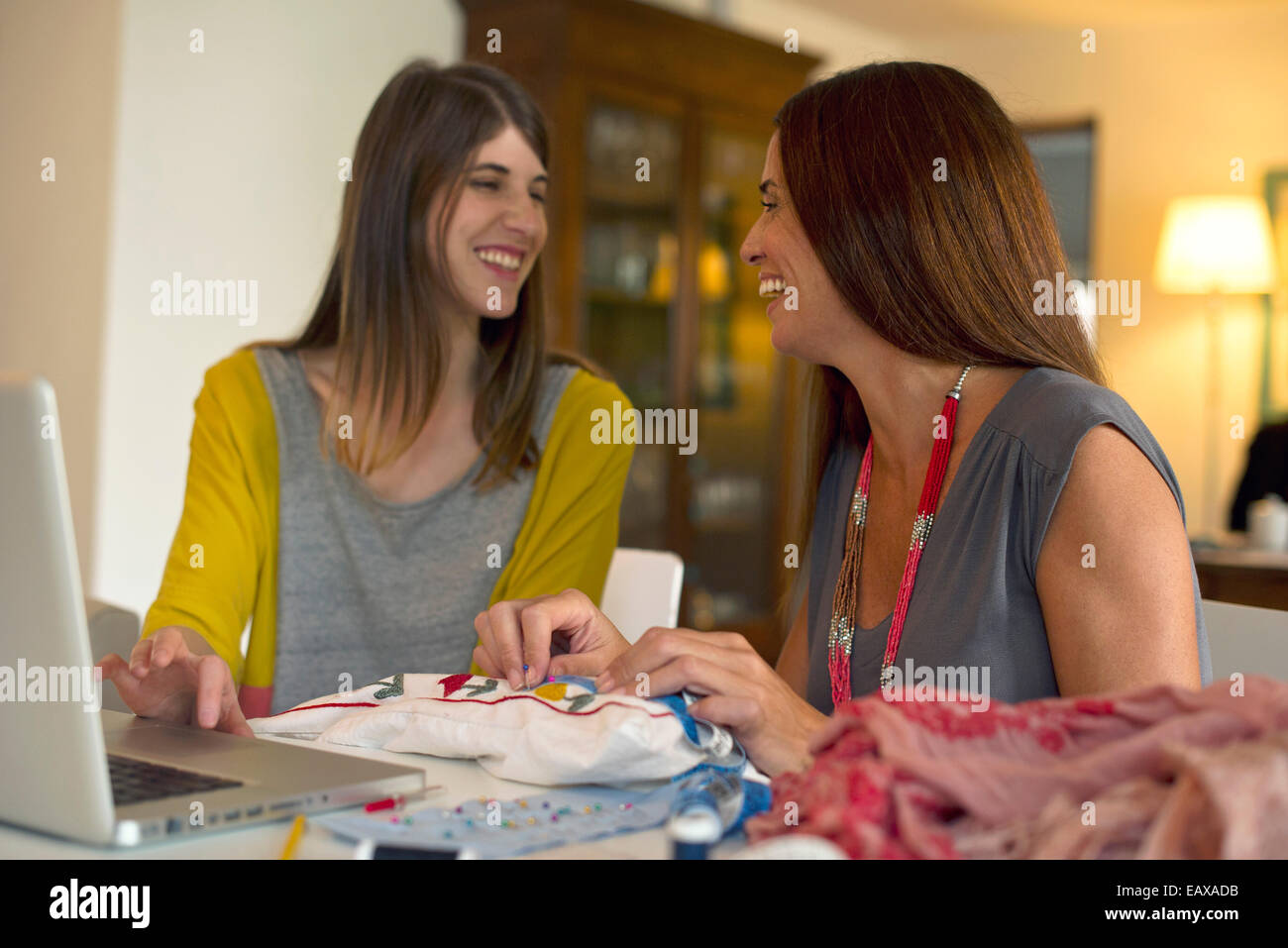Friends doing embroidery together - Stock Image