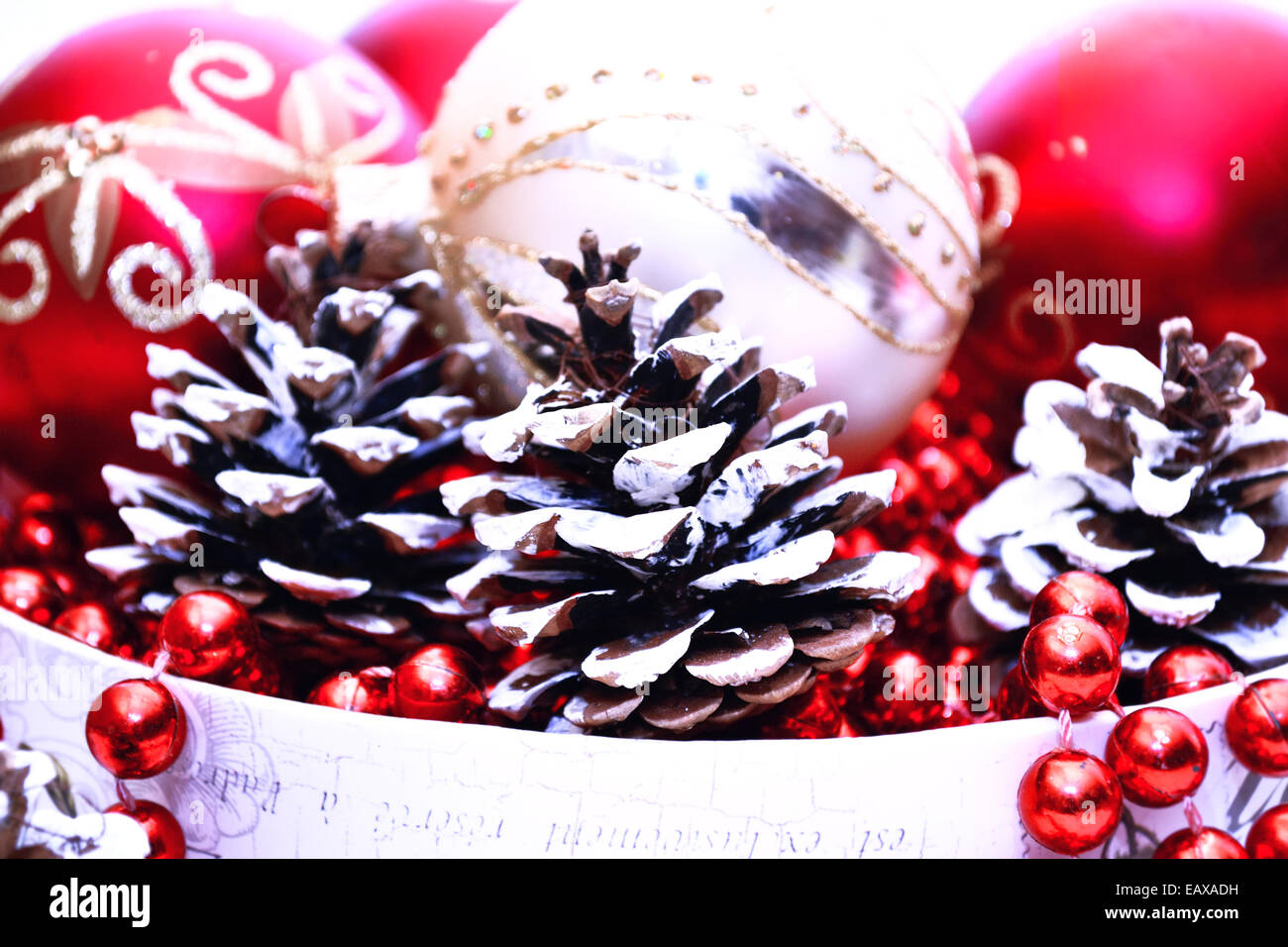 a80eb9002688 Christmas decoration with Red and Gold balls and Pine Cones on white  background