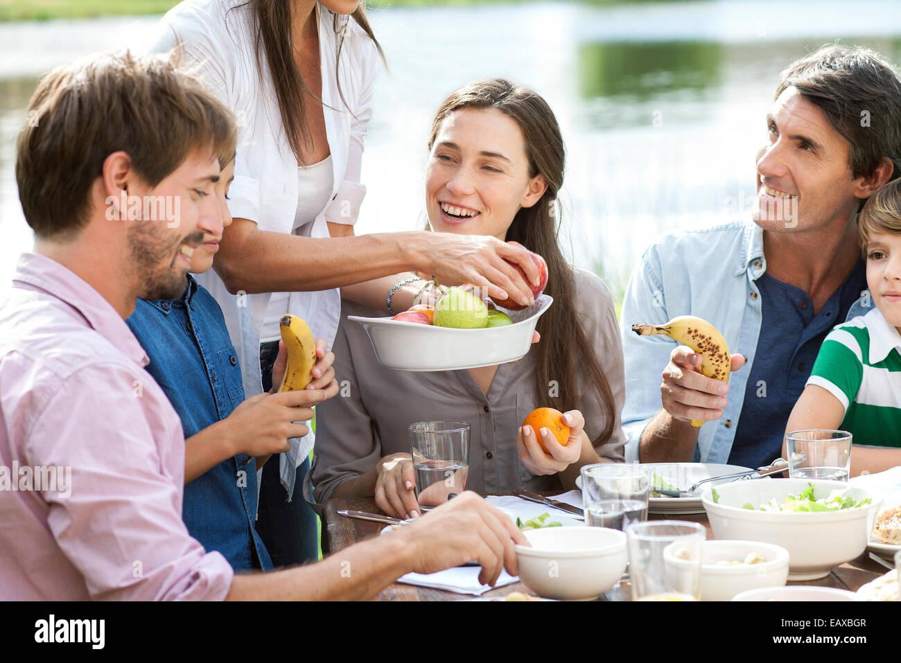 Family enjoying healthy picnic - Stock Image