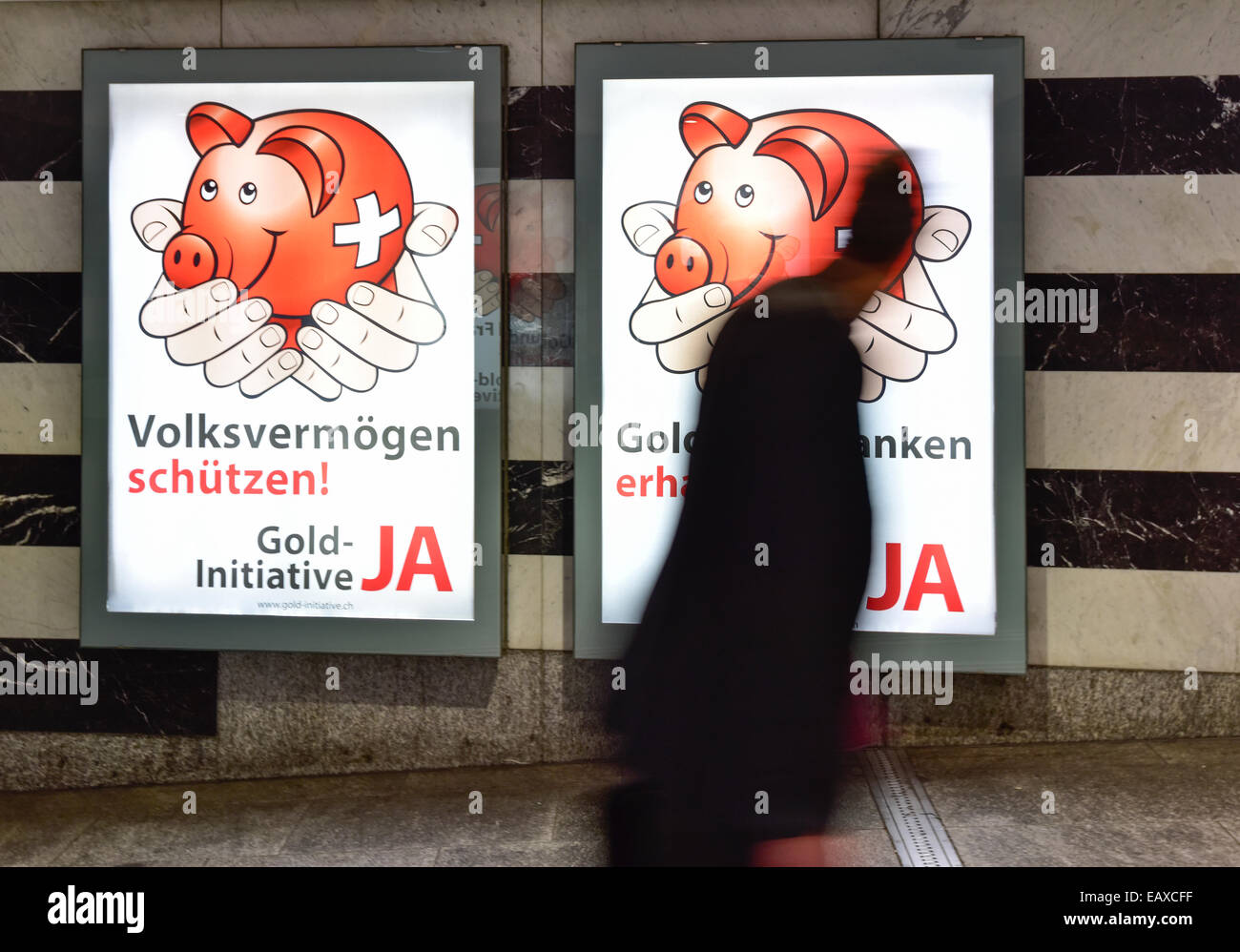 Zurich, Switzerland. 21st Nov, 2014. People at Zurich main station are passing by referendum campaign posters of - Stock Image