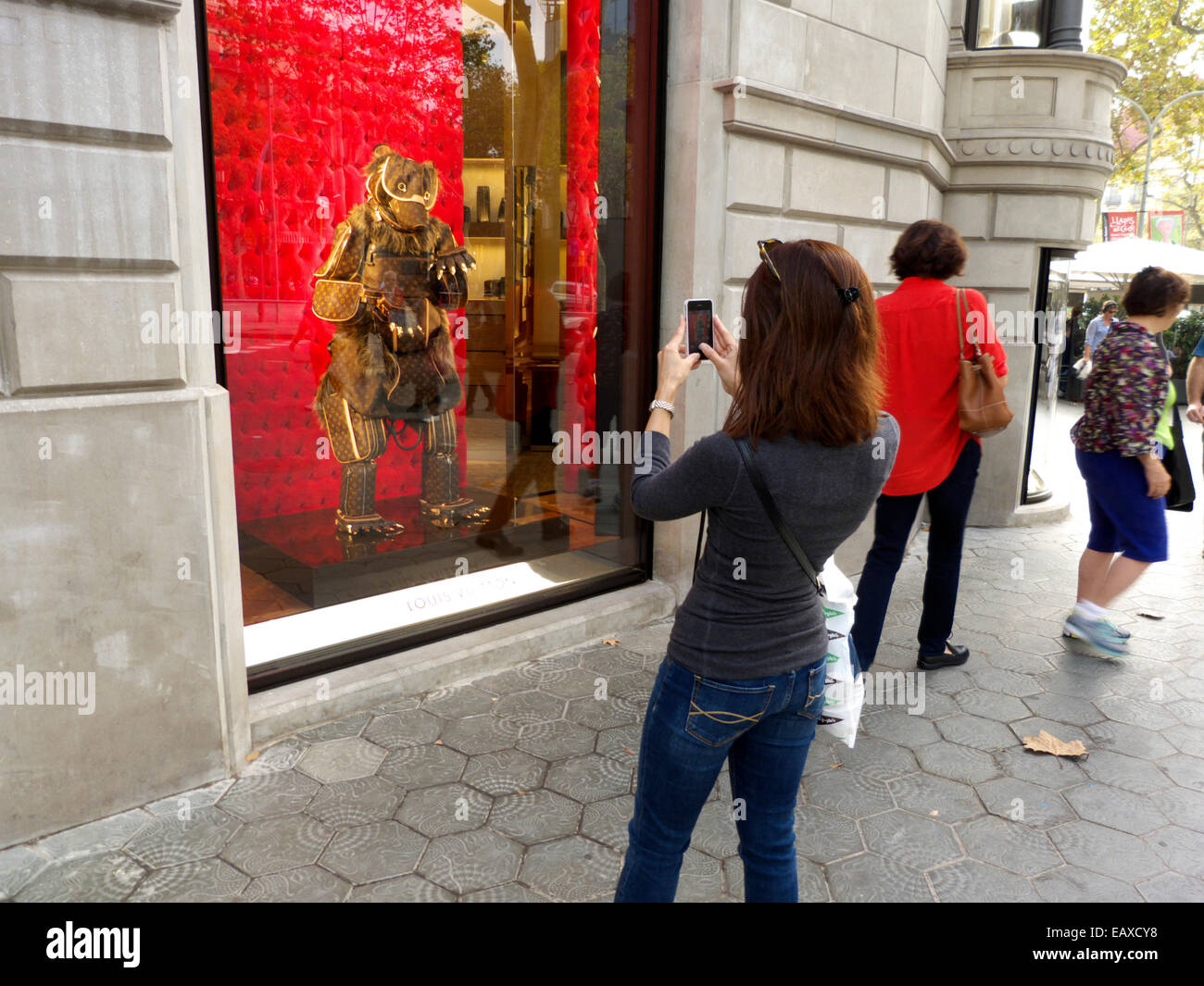 Spain Catalonia Barcelona tourist taking picture LV flagship store - Stock Image