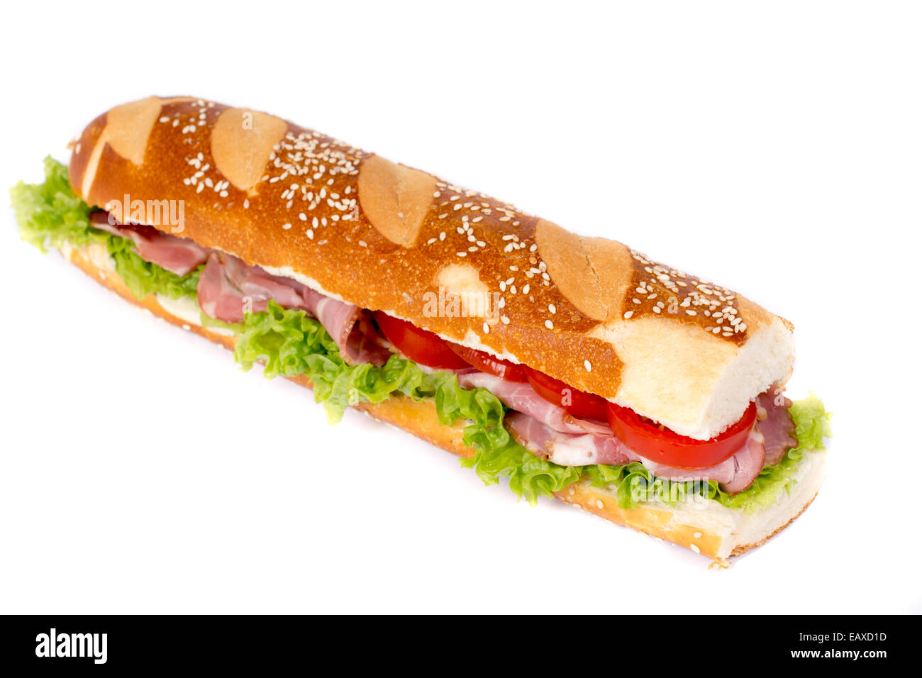 Submarine sandwich with vegetables and prosciutto isolated on white - Stock Image