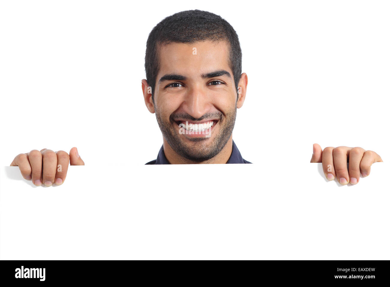 Arab happy man holding a blank banner isolated on a white background Stock Photo