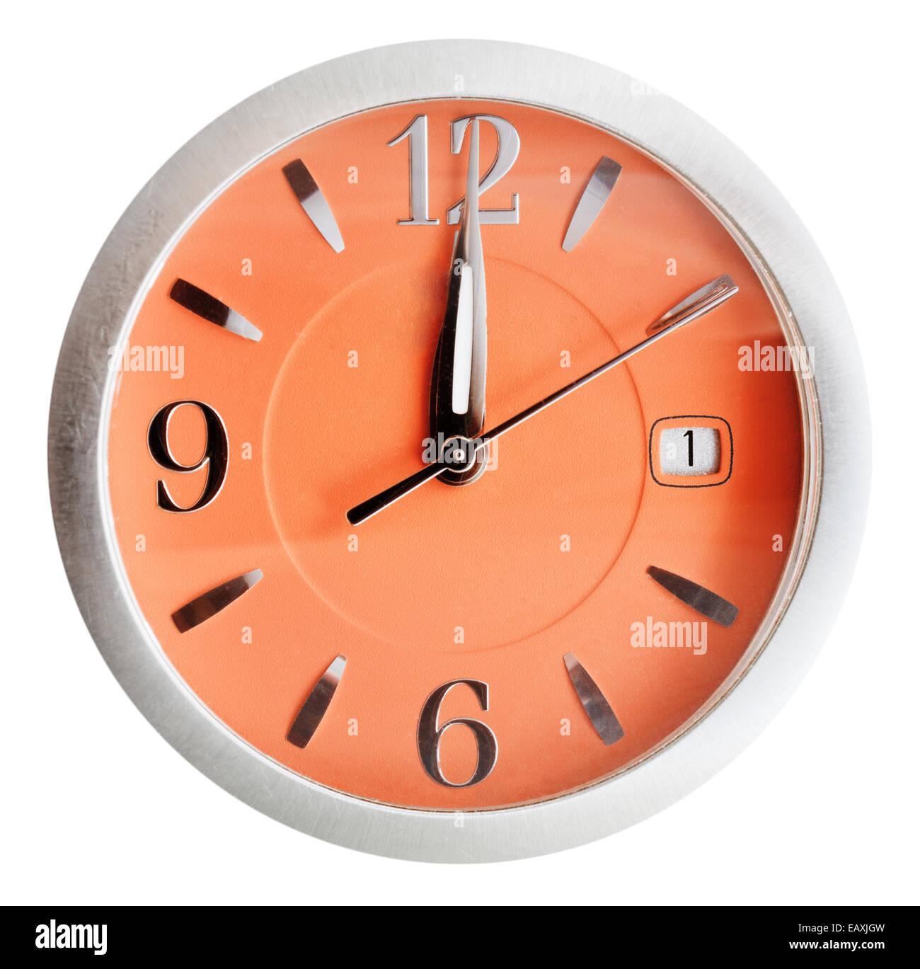 twelve o'clock on orange dial isolated on white background - Stock Image