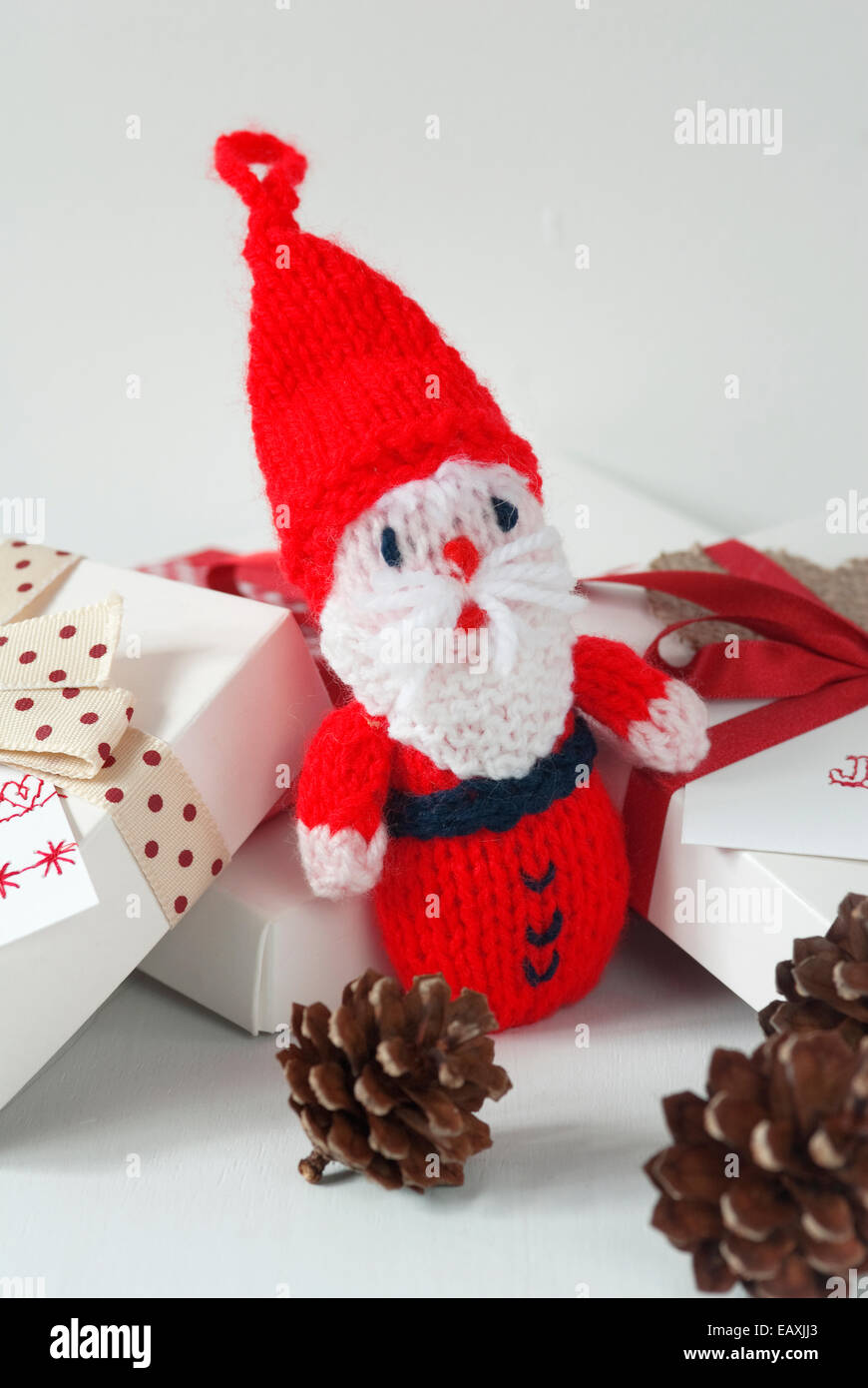 a5c20e16b2aa2 Scandinavian style still life image of knitted Santa Claus with pine cones  - Stock Image