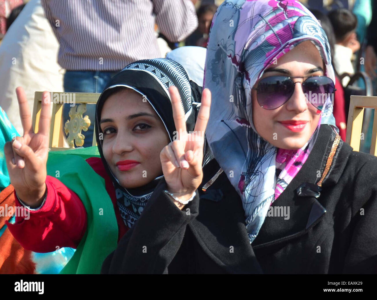 Tigresses of PTI are jubilant during political gathering as Imran Khan addressing to his supporters, at Aliabad - Stock Image