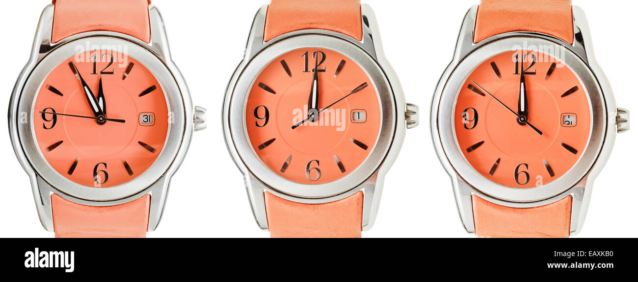 set of orange wristwatches with midnight time isolated on white background - Stock Image
