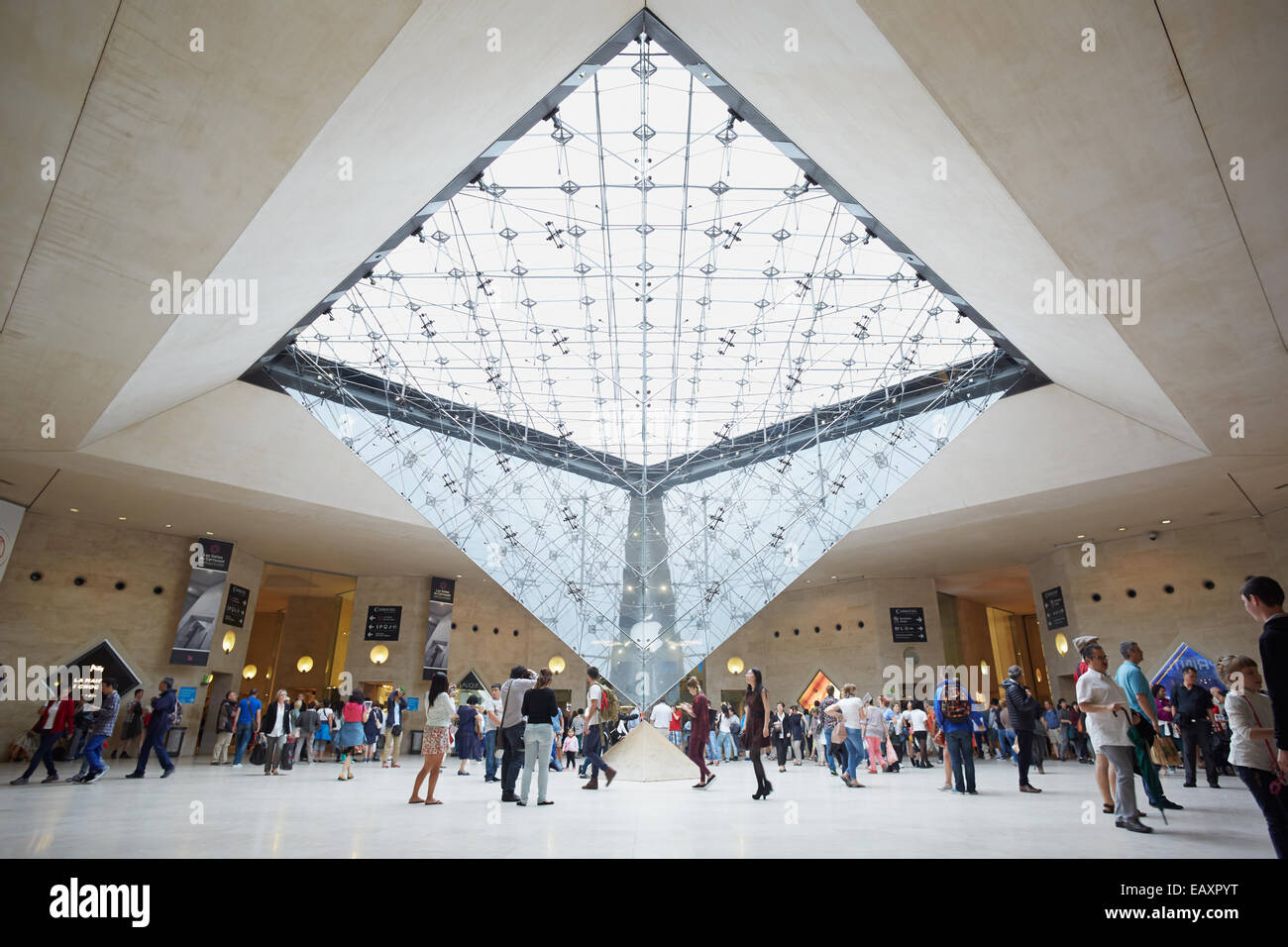 Paris, Inverted pyramid in the shopping mall 'Carrousel du Louvre' with people - Stock Image
