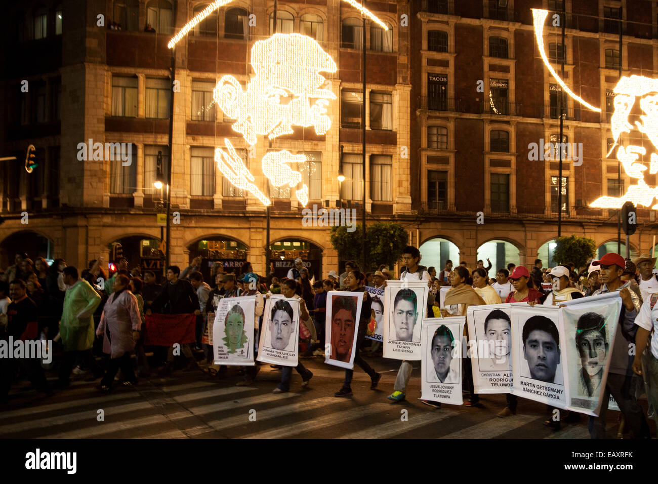 Parents and relatives of the 43 missing students from Ayotzinapa's teacher training college, hold images of the Stock Photo