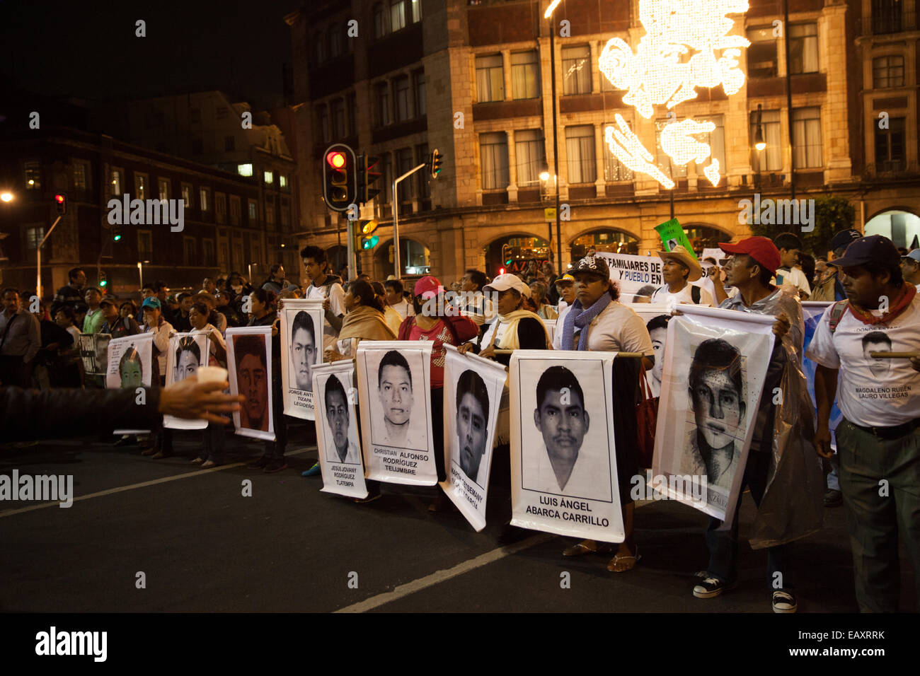 Parents and relatives of the 43 missing students from Ayotzinapa's teacher training college, hold images of the - Stock Image