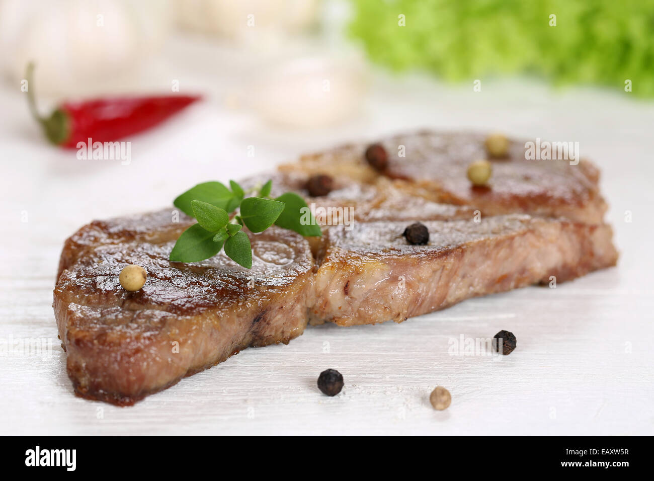 Pork chop steak cutlet meat on a wooden table - Stock Image