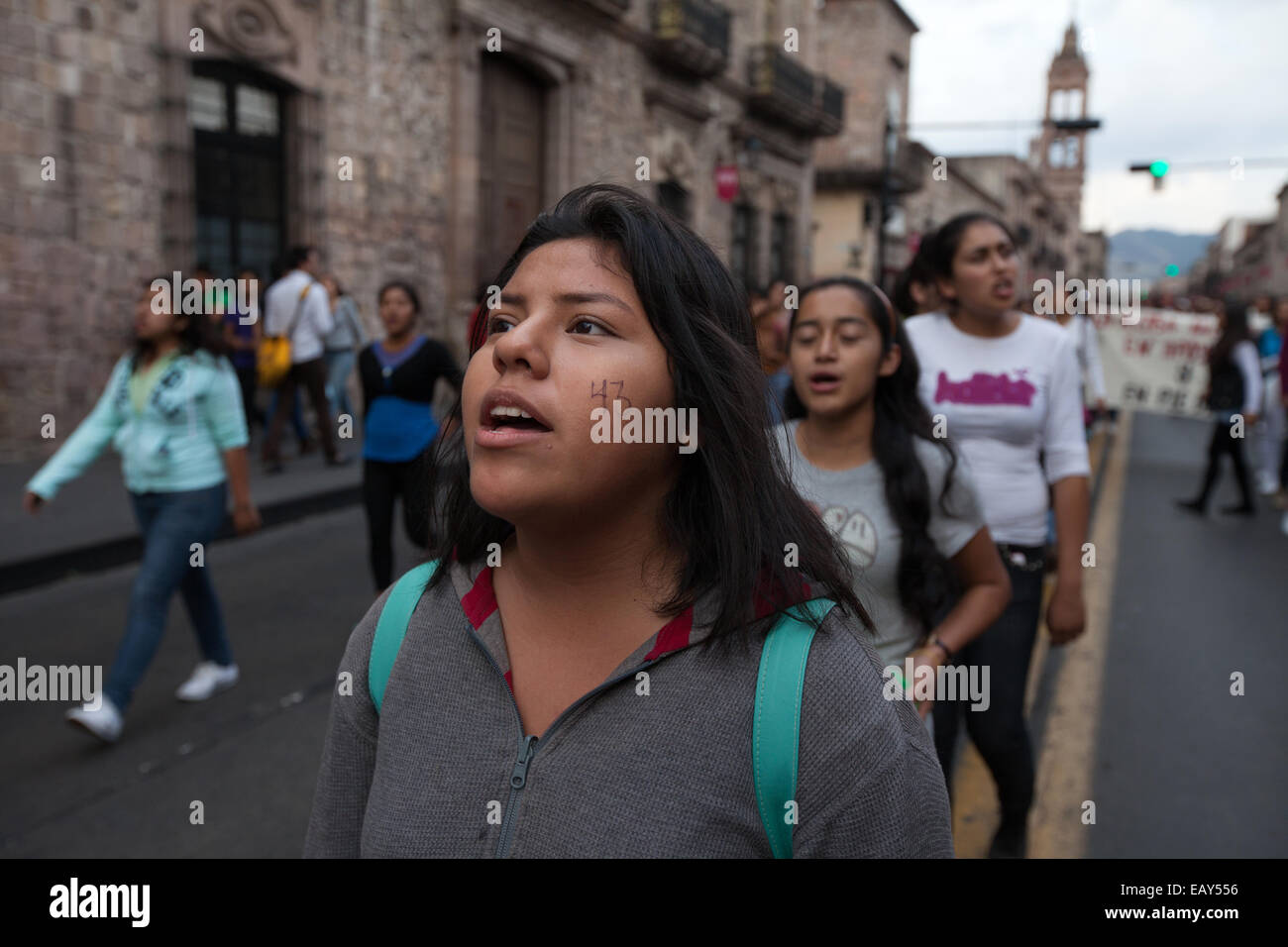 Demonstrators march to demande justice for the disappearance of 43 students from Ayotzinapa's teacher training college - Stock Image