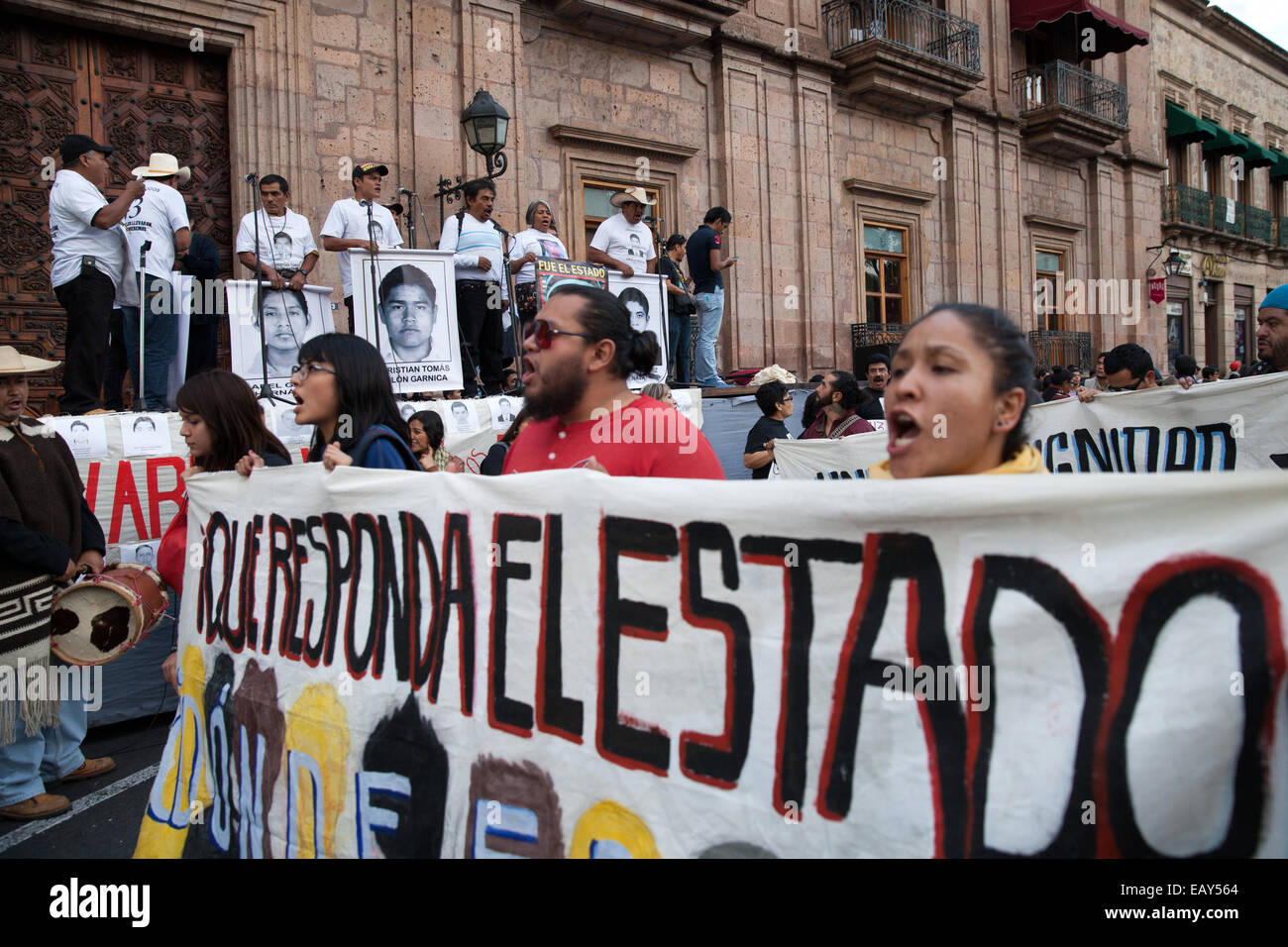 Demonstrators march to demand justice for the disappearance of 43 students from Ayotzinapa's teacher training college - Stock Image