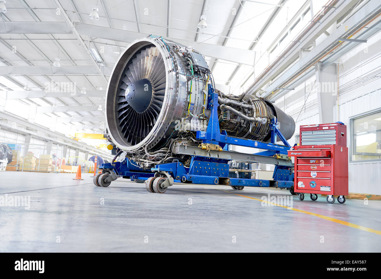 A jet engine ready to undergo maintenance - Stock Image