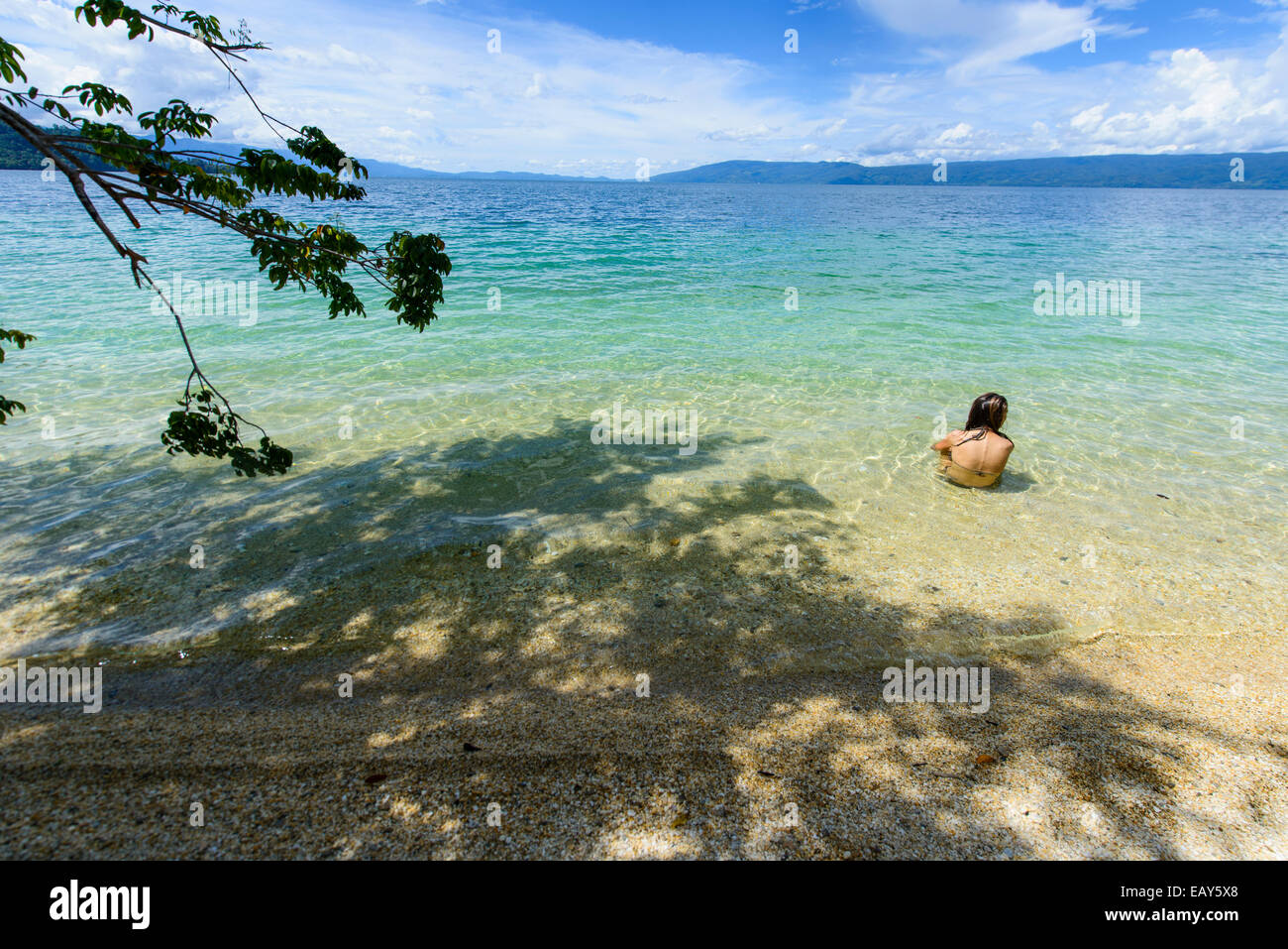 Girl on the beach, Lake Danau Poso, Sulawesi, Indonesia - Stock Image