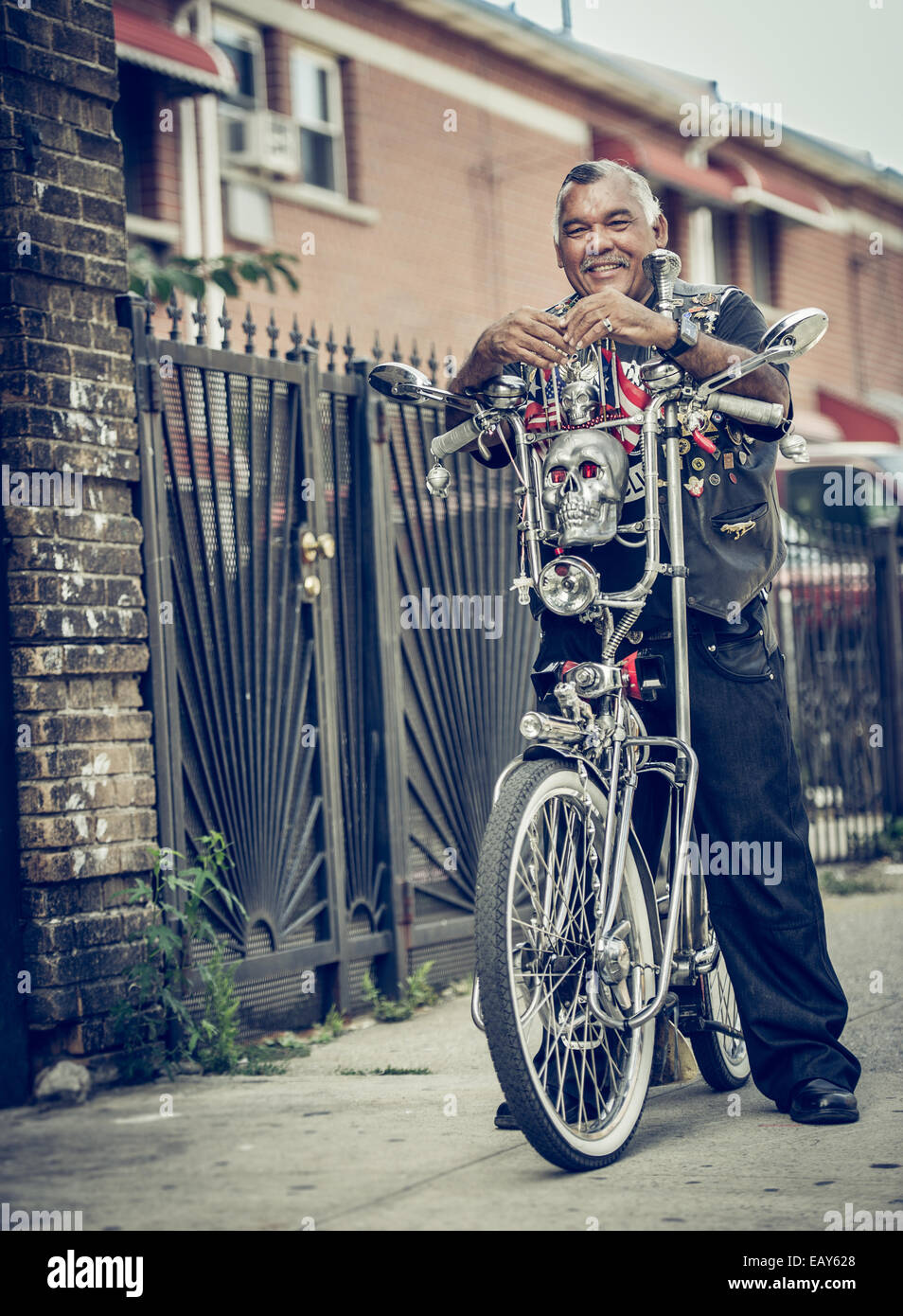 Latino man poses with his chopper bicycle - Stock Image