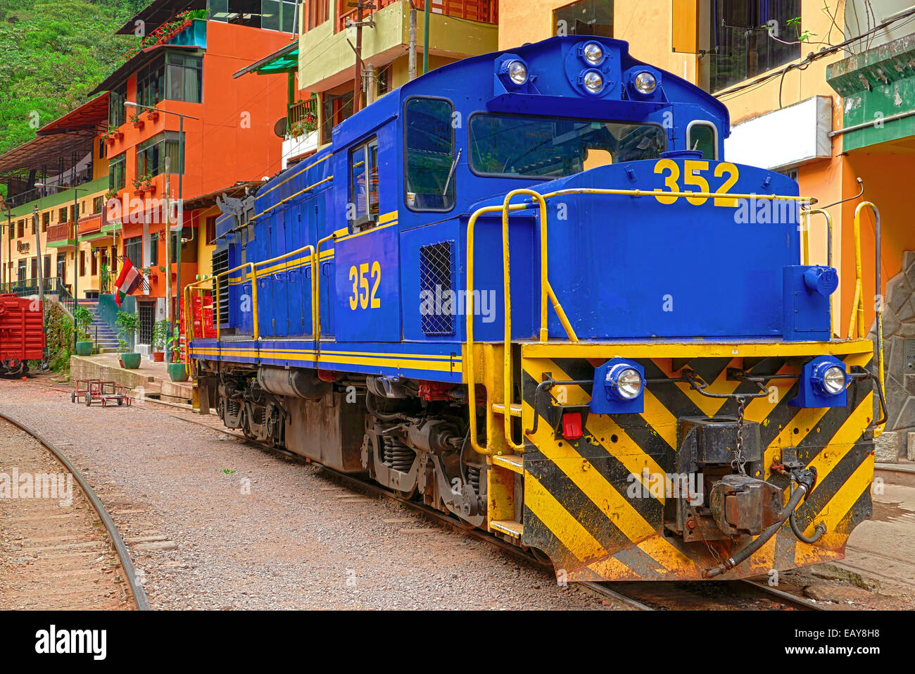 "Locomotive stands at the railway station of ""Aguas Calientes"", the suburb of ""Machu Picchu"" Stock Photo"