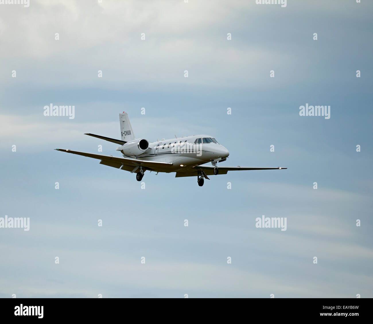 Cessna 560XL Citation Excel Business Twin engined Jet approaching Inverness Dalcross Airport.  SCO 9185 - Stock Image