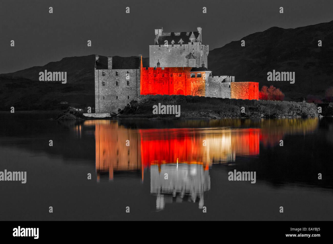 EILEAN DONAN CASTLE DORNIE EVENING  RED LIGHTS ONLY RELECT ON THE SEA LOCH FOR ARMISTICE DAY NOVEMBER 11 2014 - Stock Image