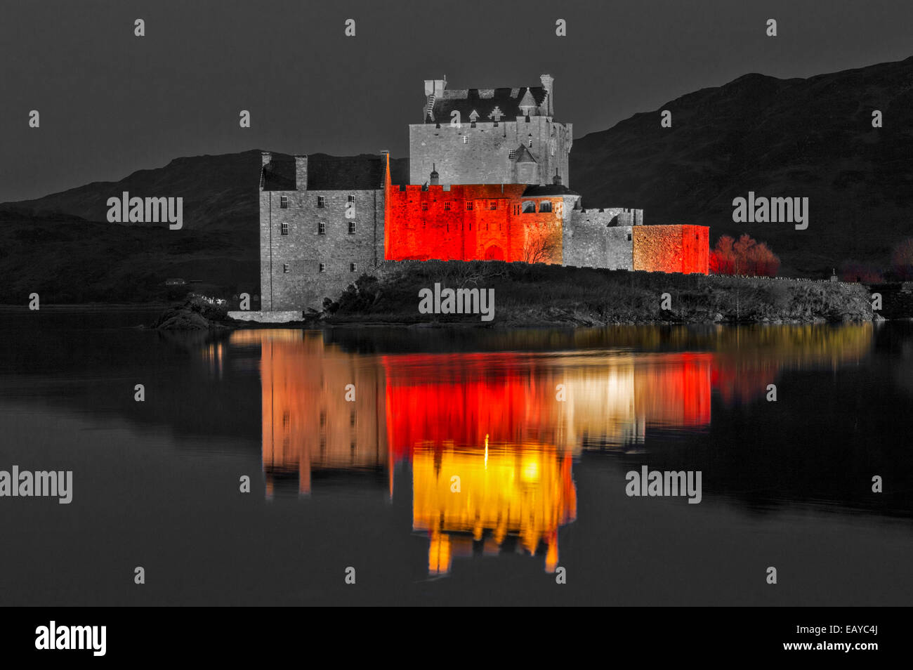 EILEAN DONAN CASTLE DORNIE EVENING  RED LIGHTS REFLECTION ON THE SEA LOCH FOR ARMISTICE DAY NOVEMBER 11 2014 - Stock Image