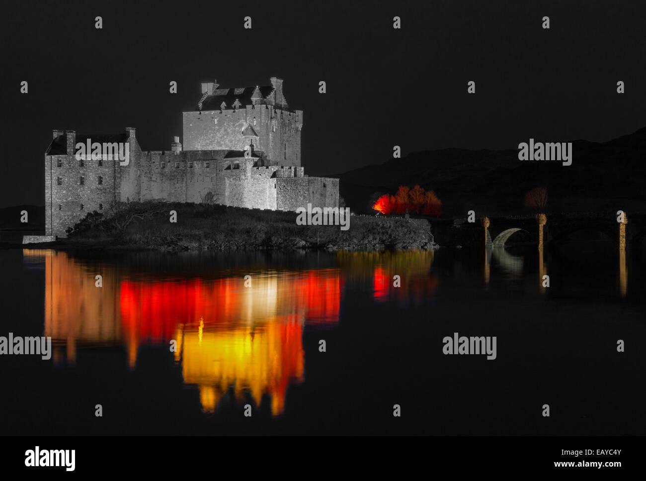 EILEAN DONAN CASTLE DORNIE WITH RED AND YELLOW COLOURED LIGHTS TO MARK ARMISTICE DAY 11 NOVEMBER 2014 - Stock Image