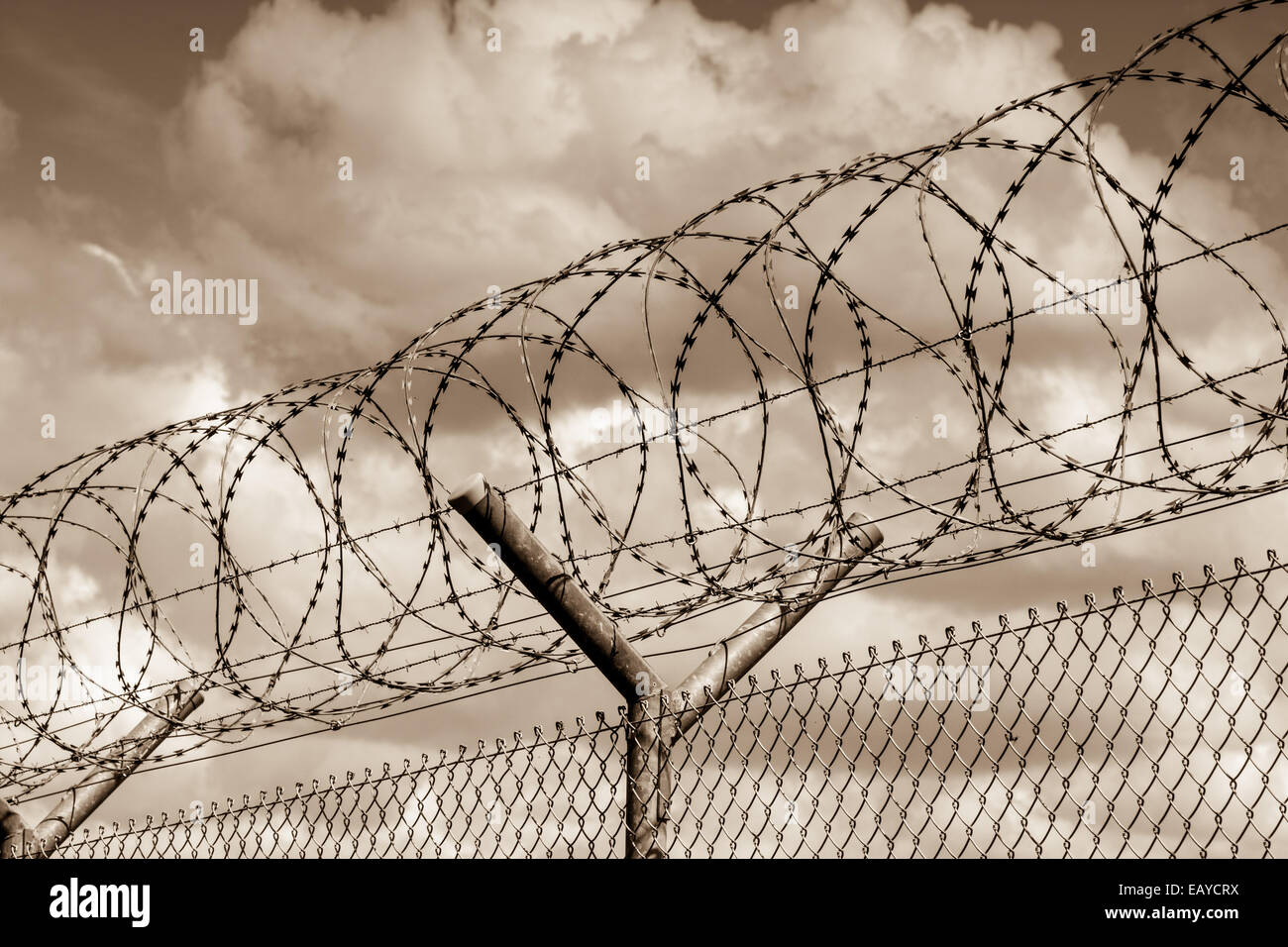 Security barrier with a barbed wire fence - Stock Image