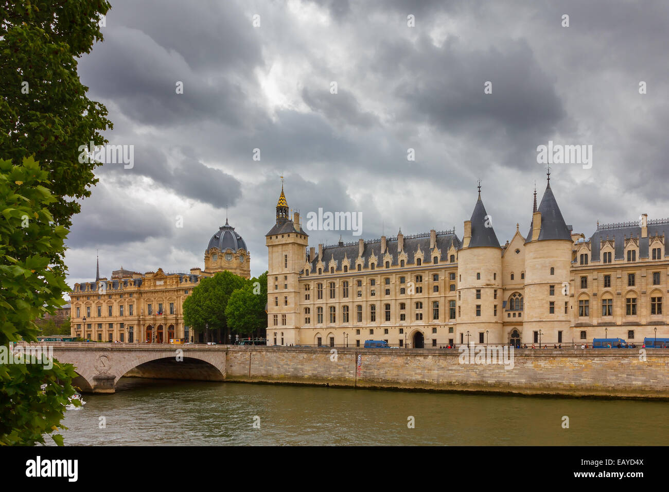 Pont au Change over the Seine River,  Palais de Justice and the Conciergerie in Paris, France Stock Photo