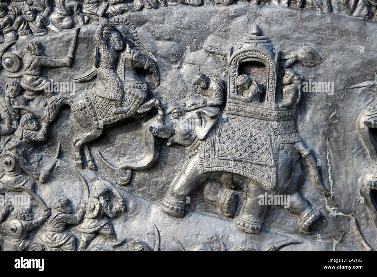 Close-up of bas-relief carving of Haldighat war scene at Pratap Smarak on Moti Magri Hill in Udaipur, Gujarat, India, - Stock Image