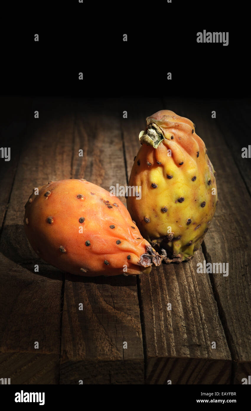 Prickly Pears on wooden background - Stock Image