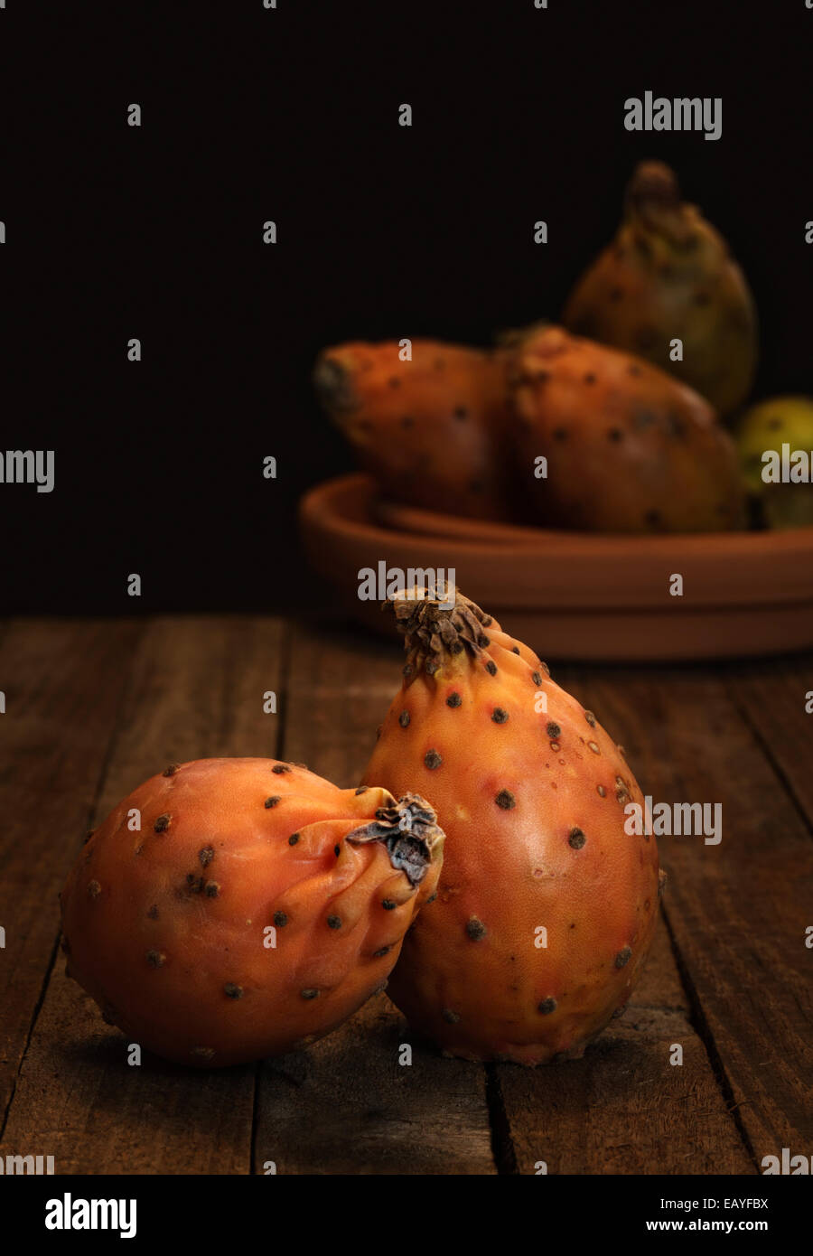 Prickly Pears on wooden Table - Stock Image