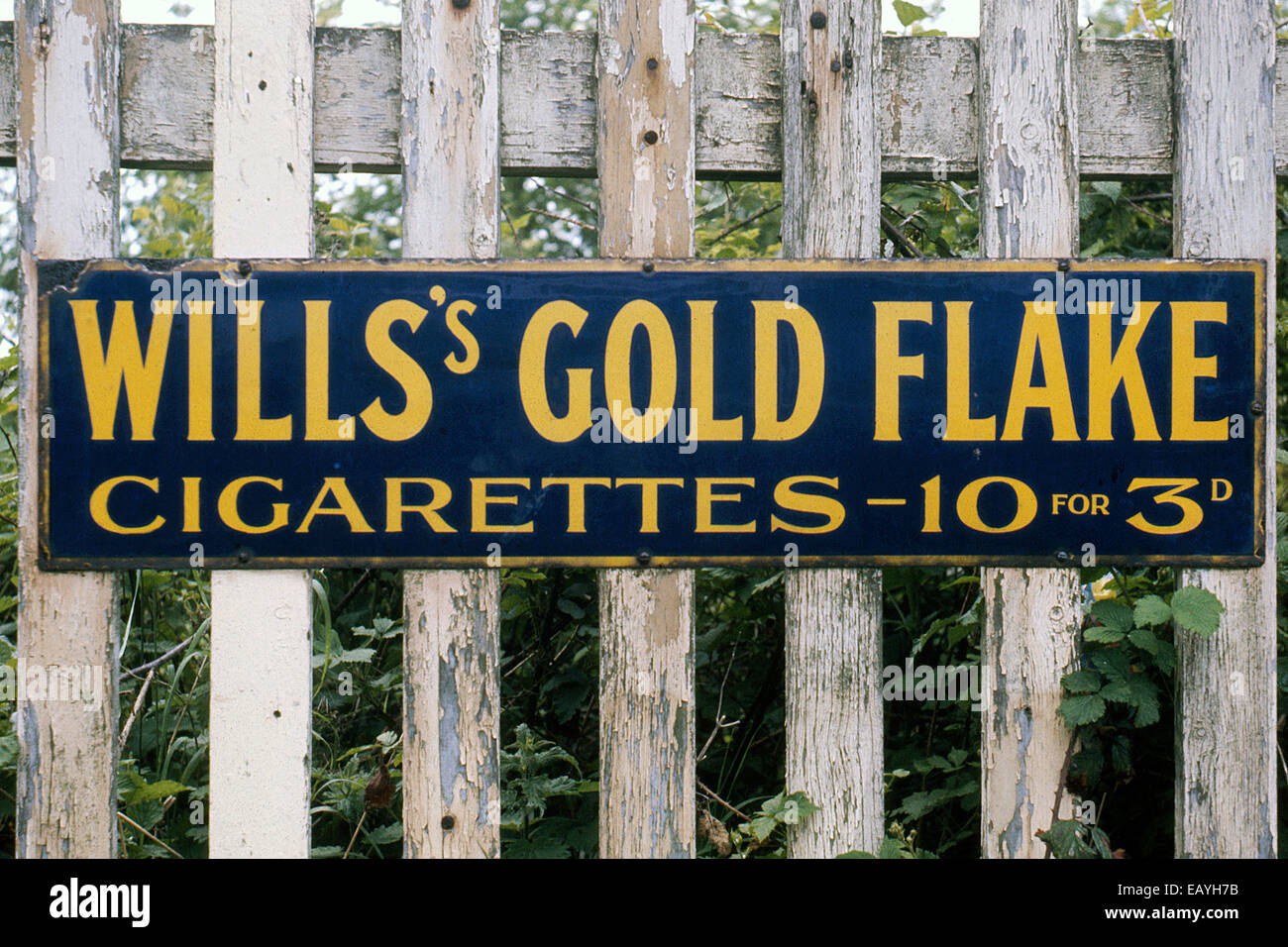 Enamelled advertising sign Wills's Gold Flake cigarettes - Stock Image
