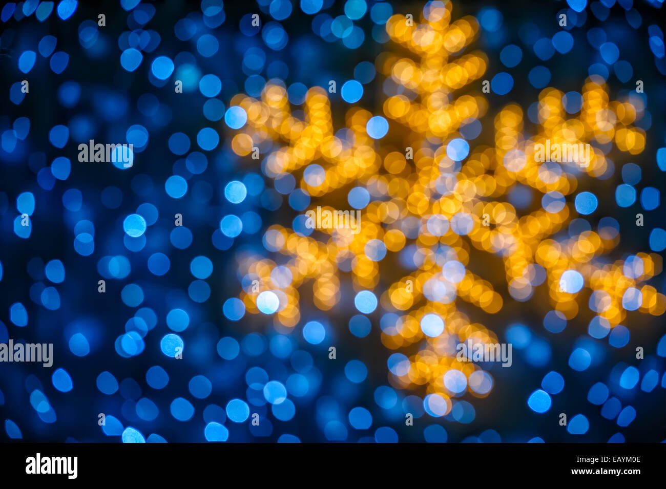 Christmas background with blurred snowflake and blue lights - Stock Image