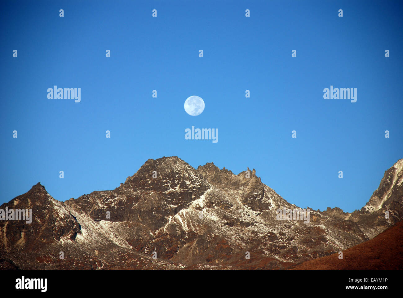 The moon rises above the Himalayan foothills in the Indian state of Sikkim - Stock Image