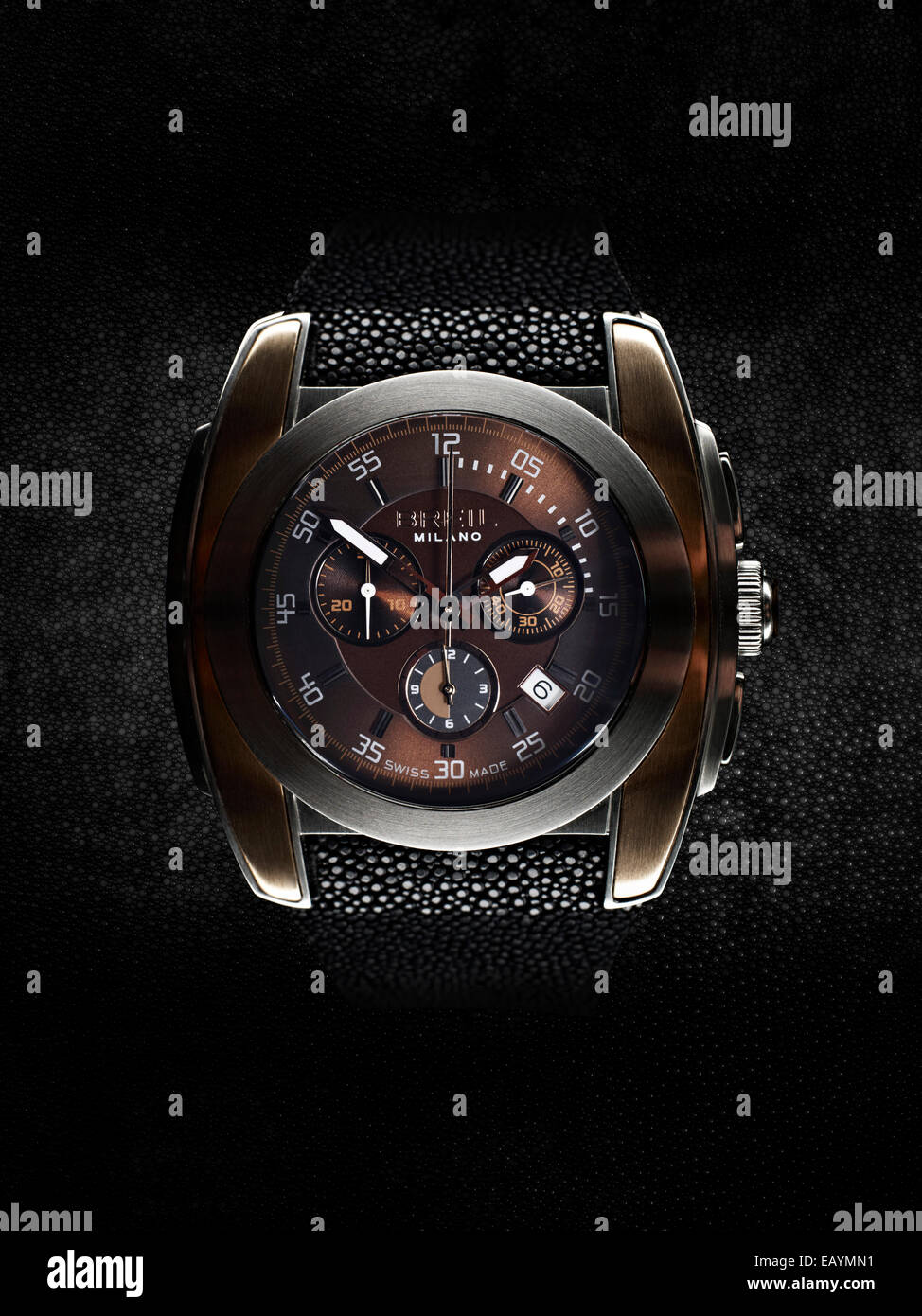 Studio still life image of a Briel chronograph watch with shagreen strap on black shagreen background. - Stock Image