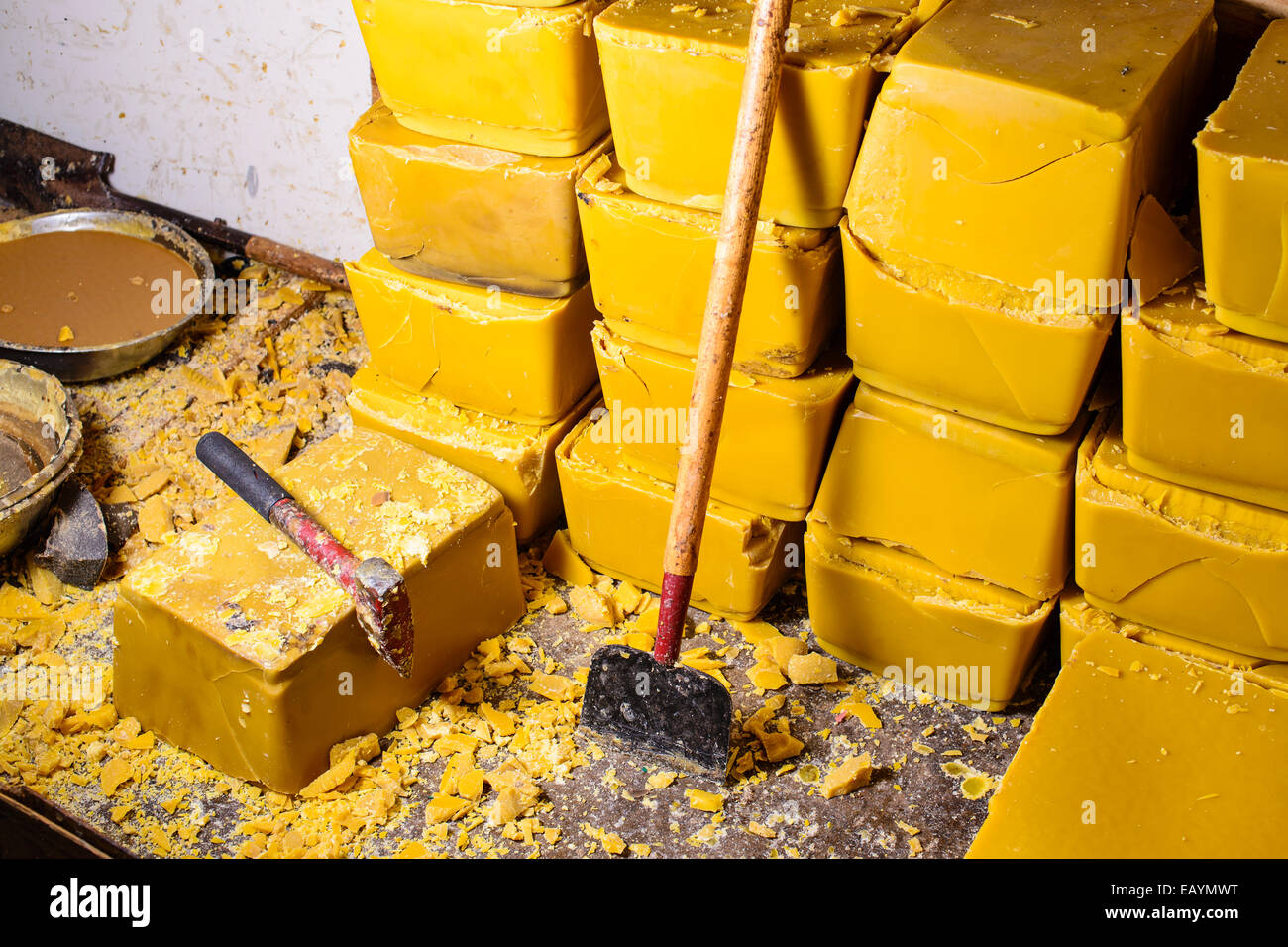 Blocks of beeswax for candle making. - Stock Image